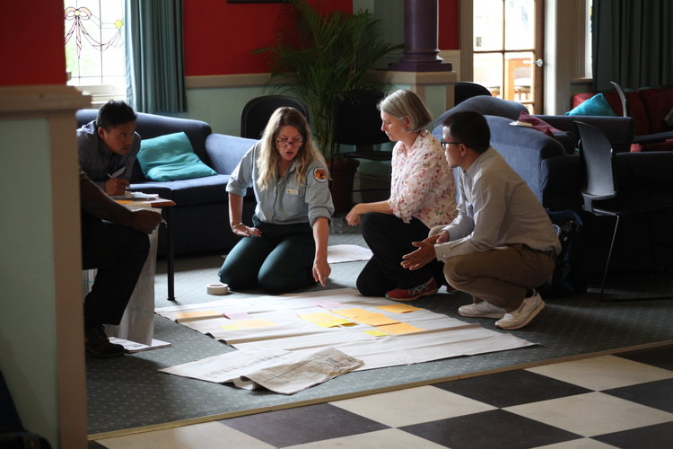 Course participants discuss their adaptive management plans with a NSW National Parks & Wildlife service officer