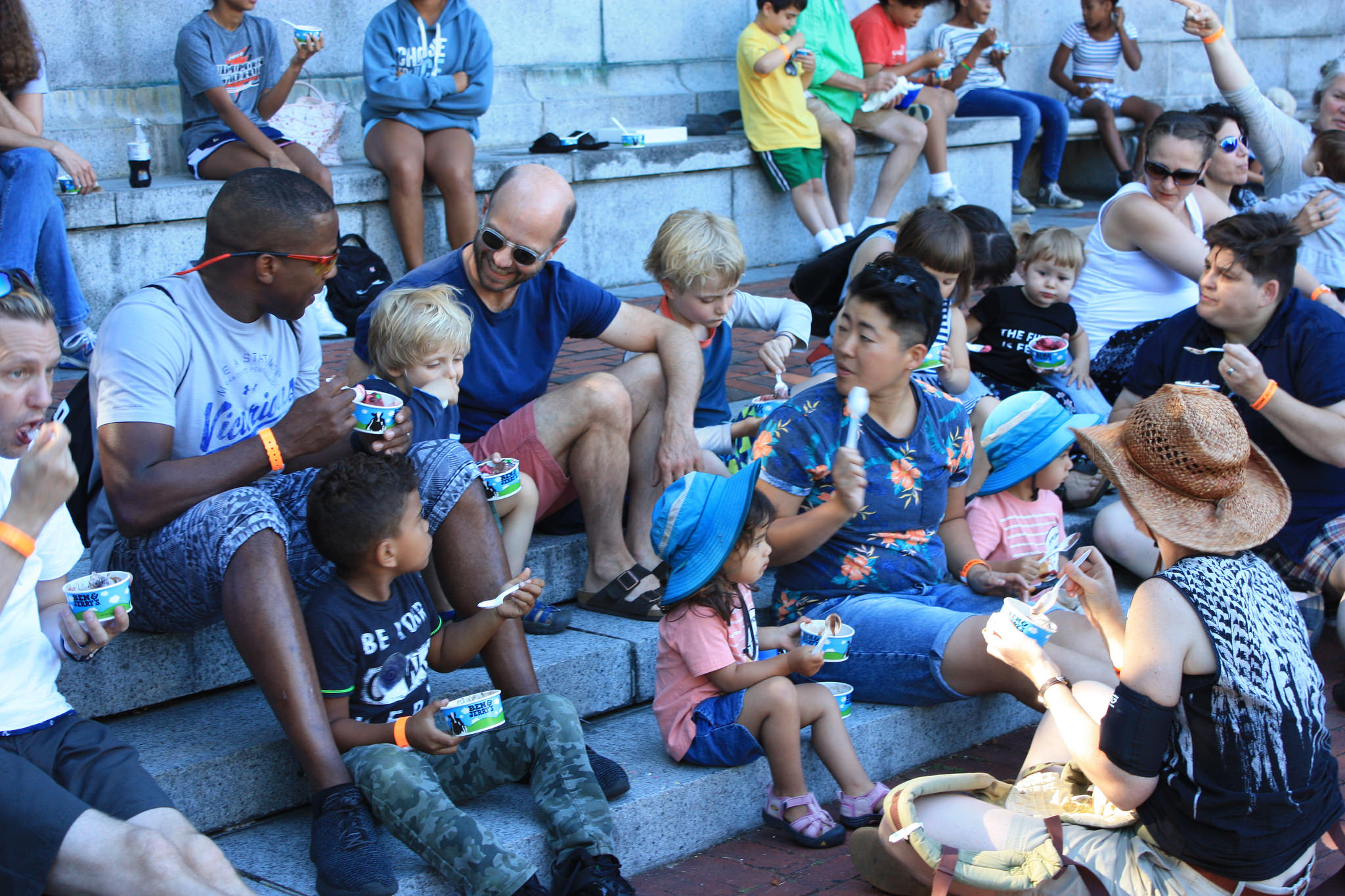 Families eating ice cream at the Multi-Racial Family Ice Cream Social