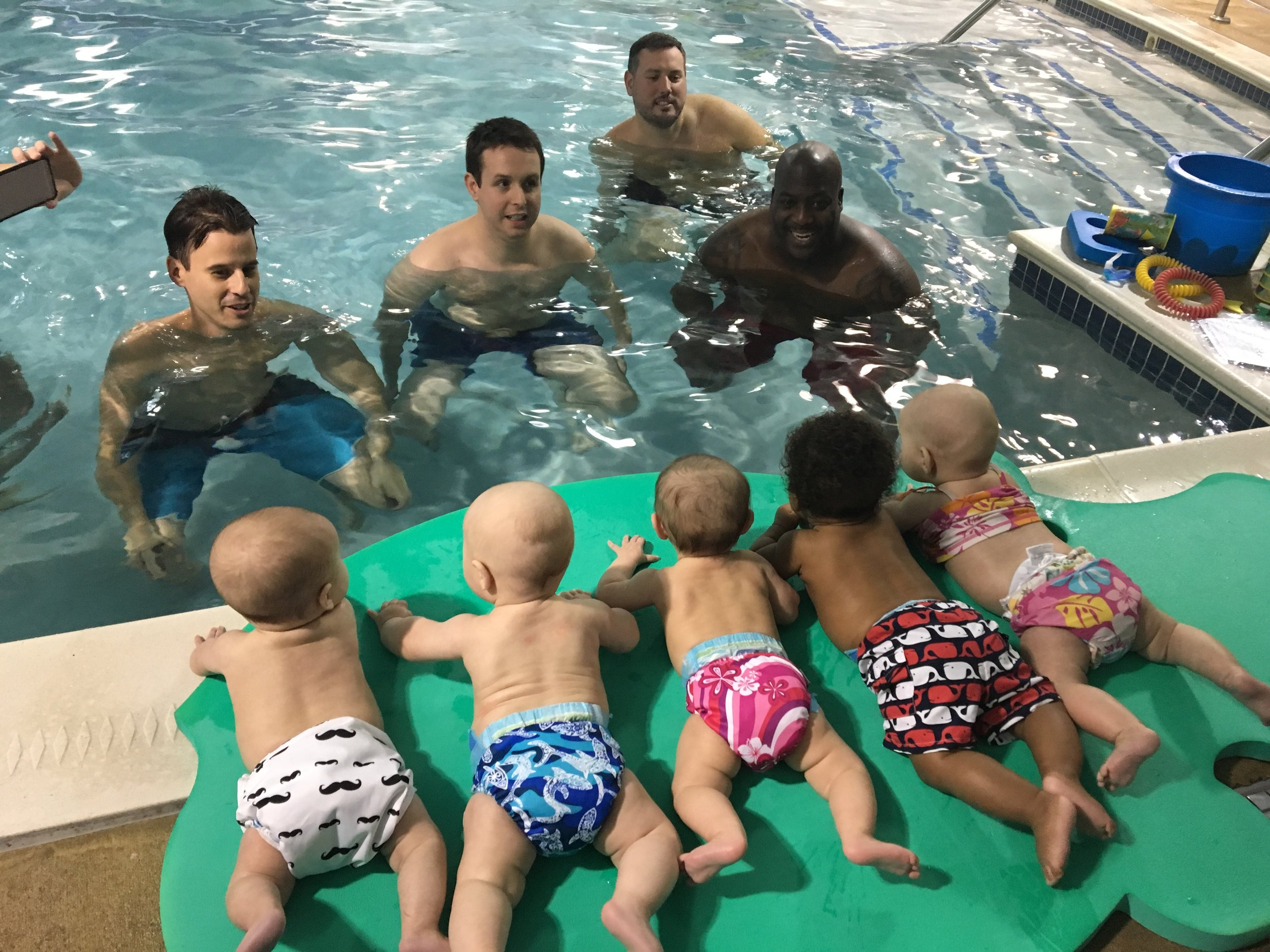 Swim Class- Asher at swim class with daddy and his buddies.  He started swimming lessons at two months!