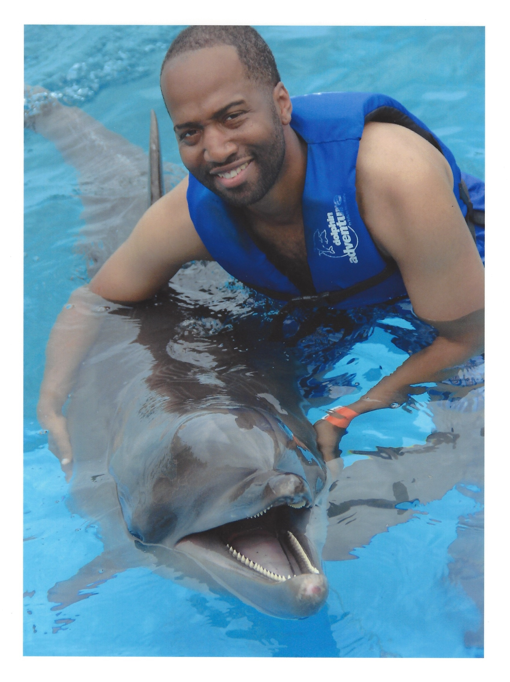 Anthony swimming with dolphins