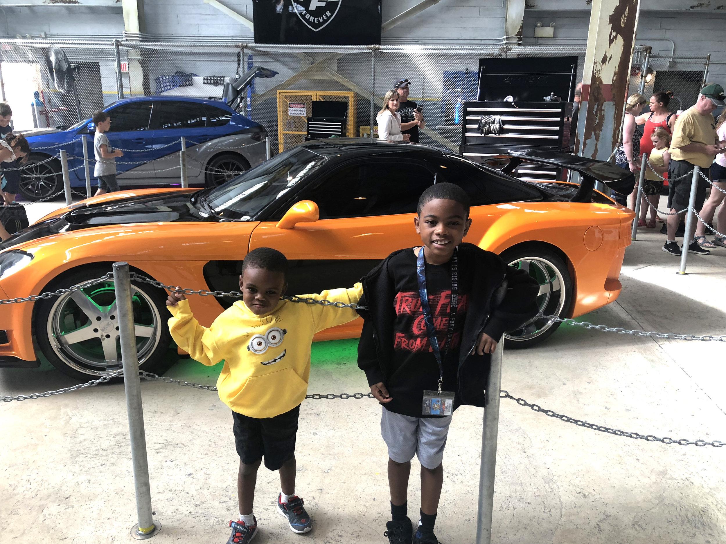 The boys enjoying a car show