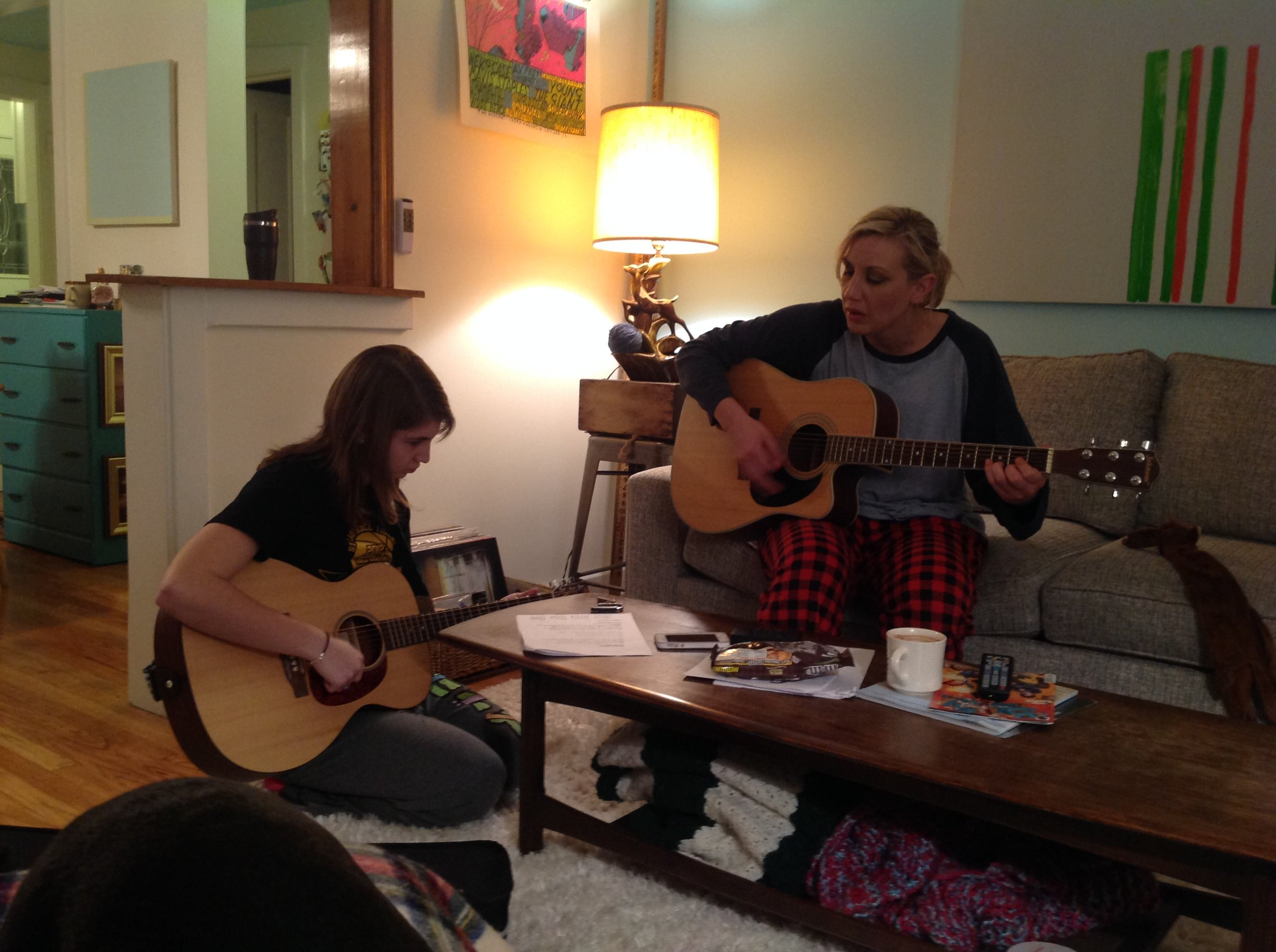 Playing guitar with family.