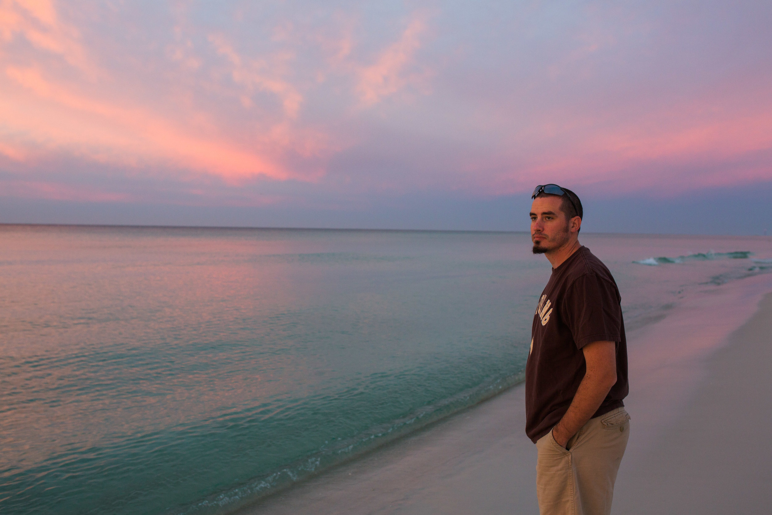 Mikal checking out a gorgeous sunrise at the beach