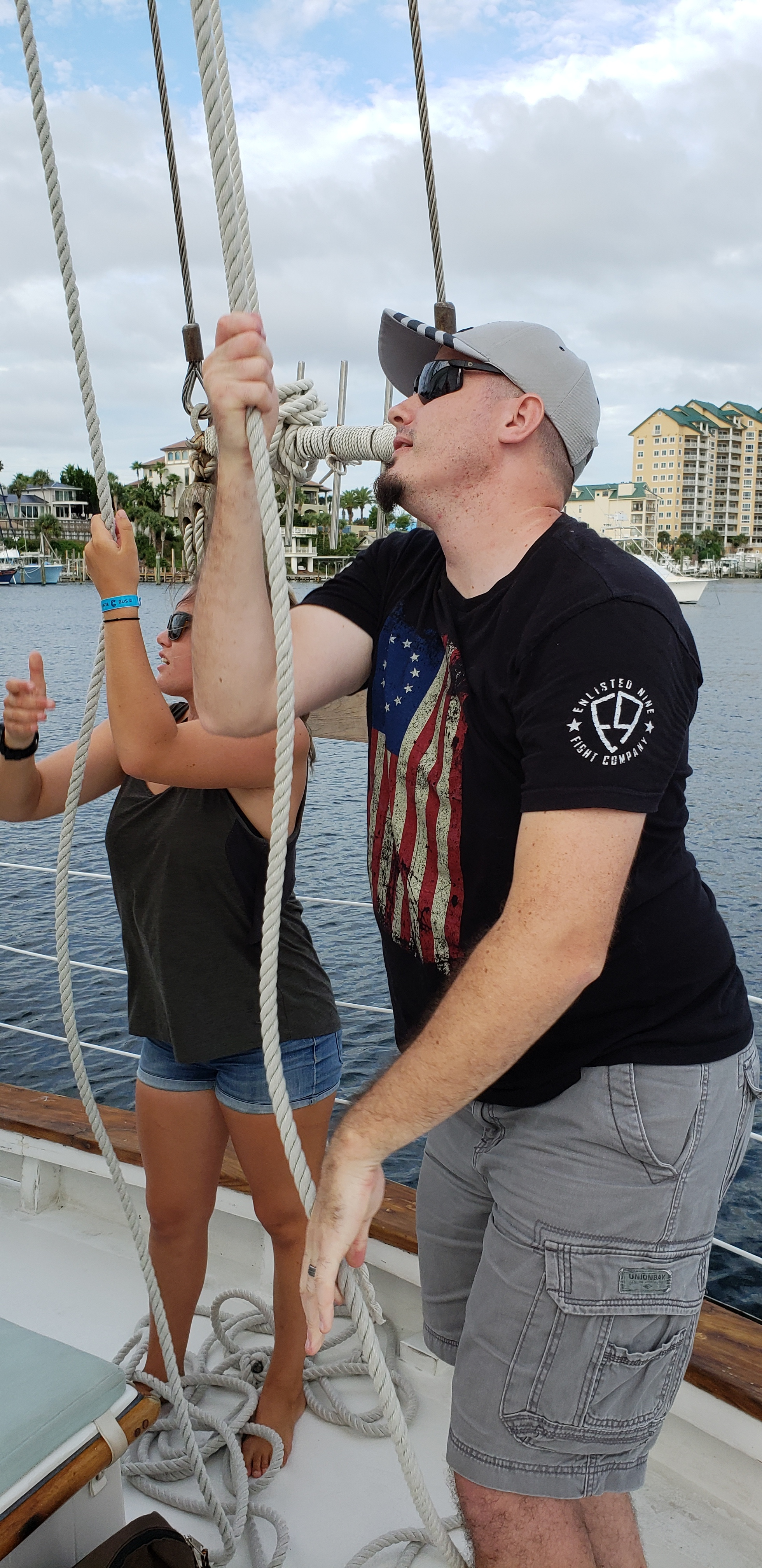 Mikal got to help raise the sails on our sunset sailboat cruise