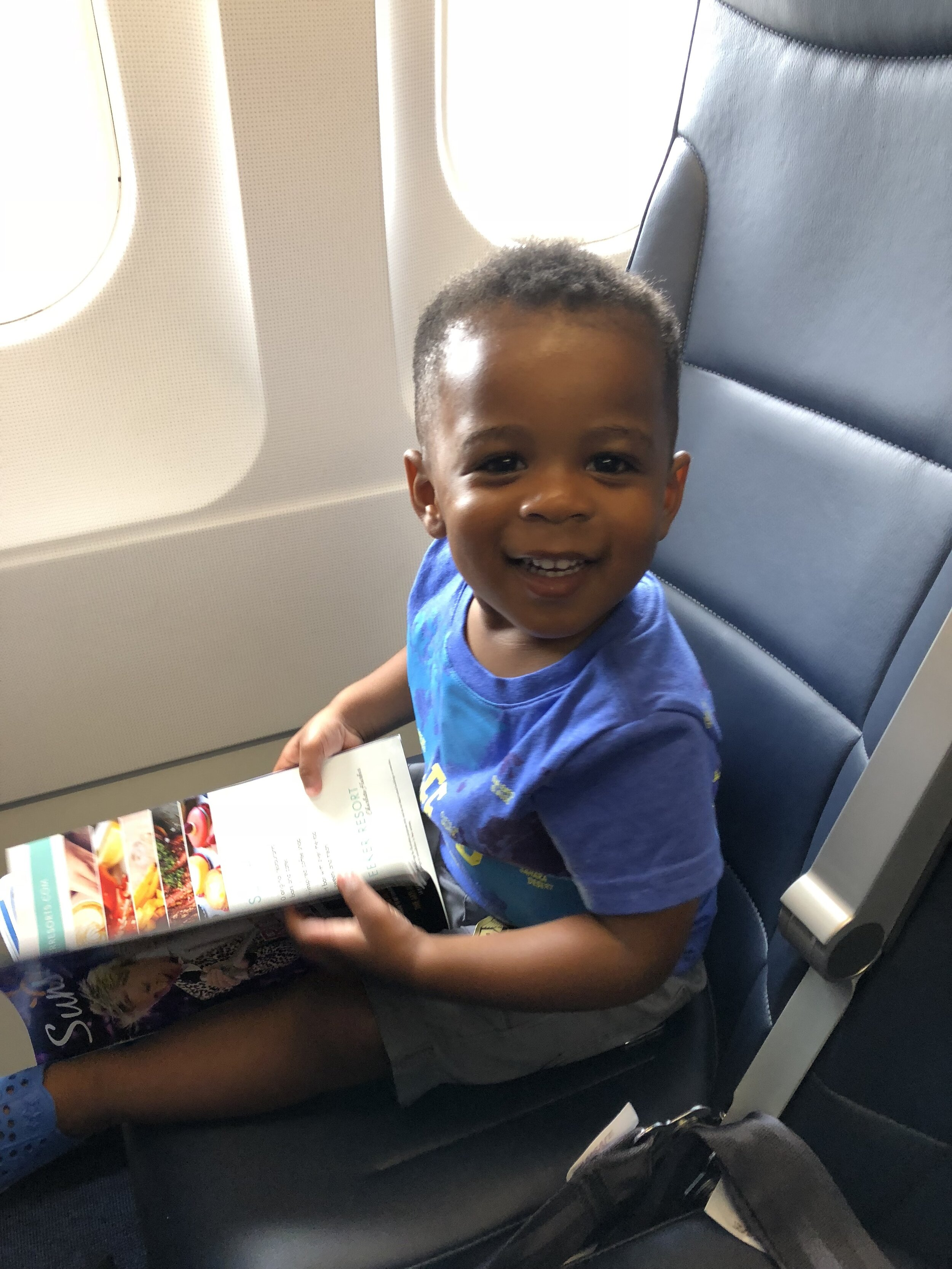 Maxwell on a flight to visit the grandparents in Florida