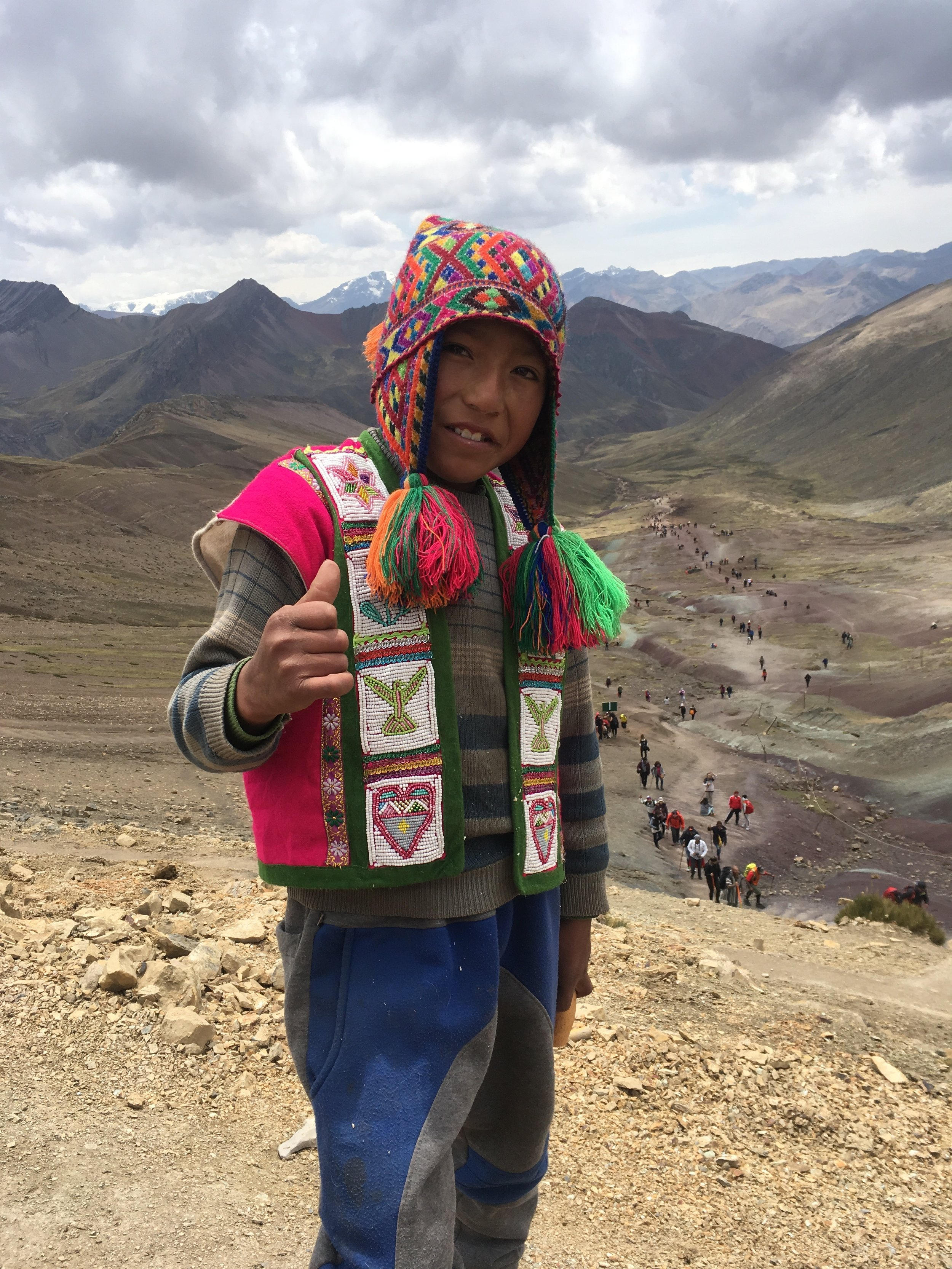 This little boy asked for 1 Sole for this picture. Behind him, you can see the trail up the valley.