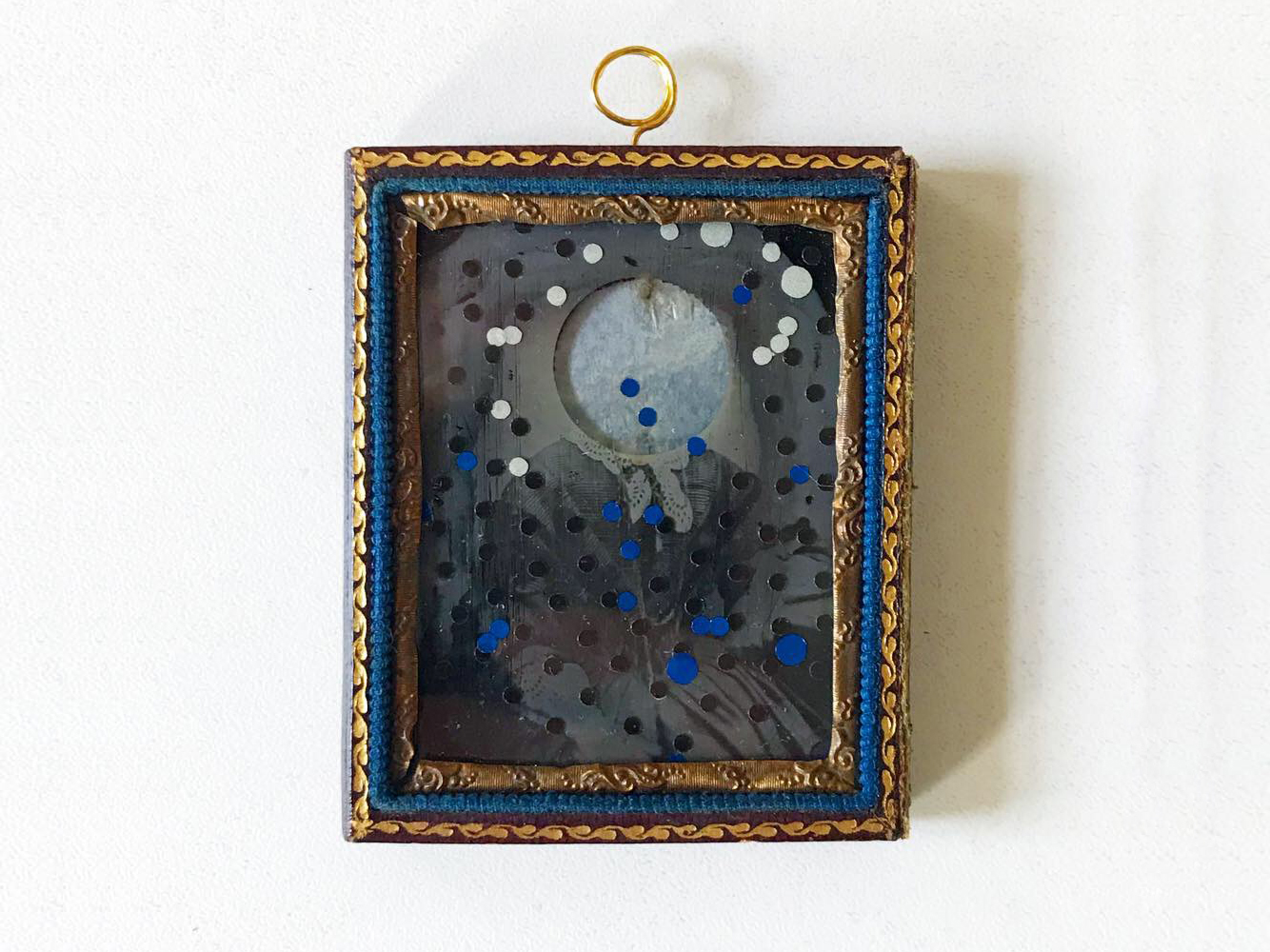Sanctae Mariae coronam scriptor de caelum   (Holy Mary's heavenly crown) , 2018  Redrafted ambrotype with reflective film and Lunaria pod casing,   7.5 x 6.2 cm