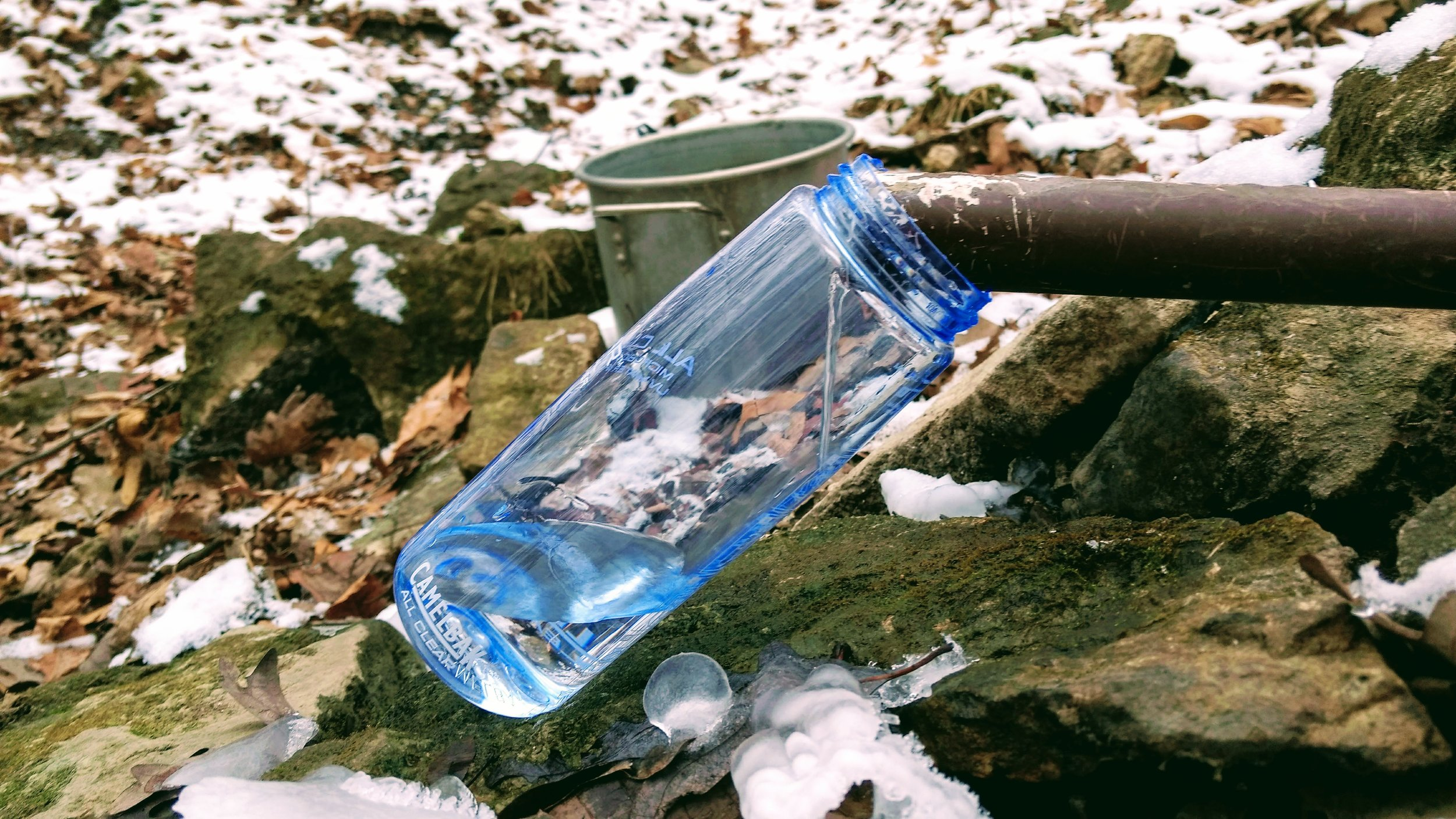 Collecting spring water to make mead