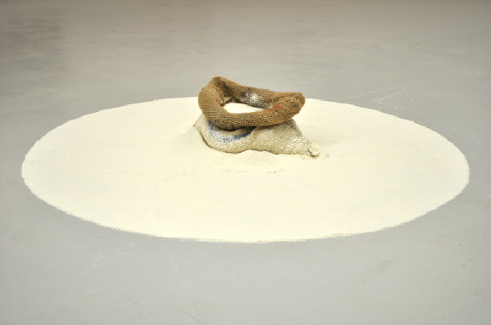 - Ben Loong, Ant Mill, 2012,burlap, flour.Image courtesy of the artist.