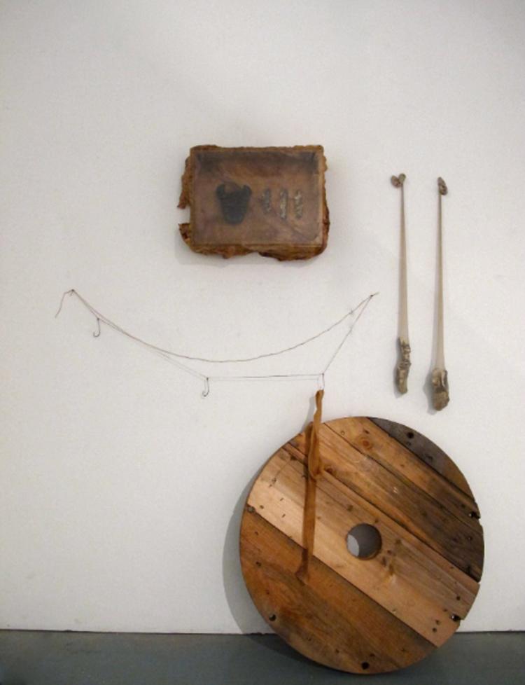 - Ben Loong, Temple, 2012, timber, glazed ceramic, stockings, meat hooks, hemp, bandage, shellac.Image courtesy of the artist.