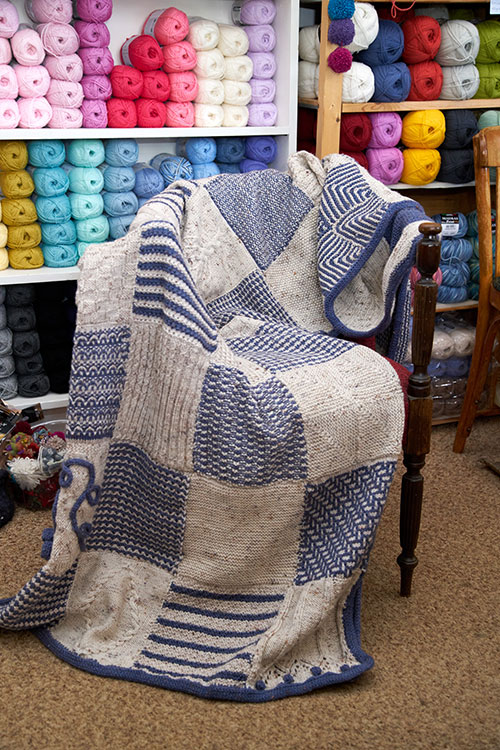 The beautiful hand-knitted wool blanket to be raffled to raise funds for local family — stunningly crafted by the Uralla Knitting Group. [Image courtesy of  New England Focus  magazine.]