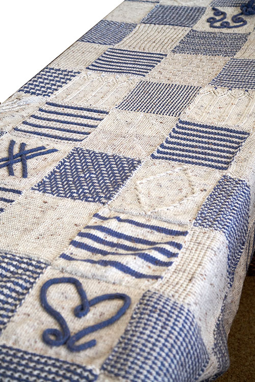 The hand-knitted, queen-sized blanket is made from Cleckheaton Country 8ply wool. [Image courtesy of  New England Focus  magazine.]
