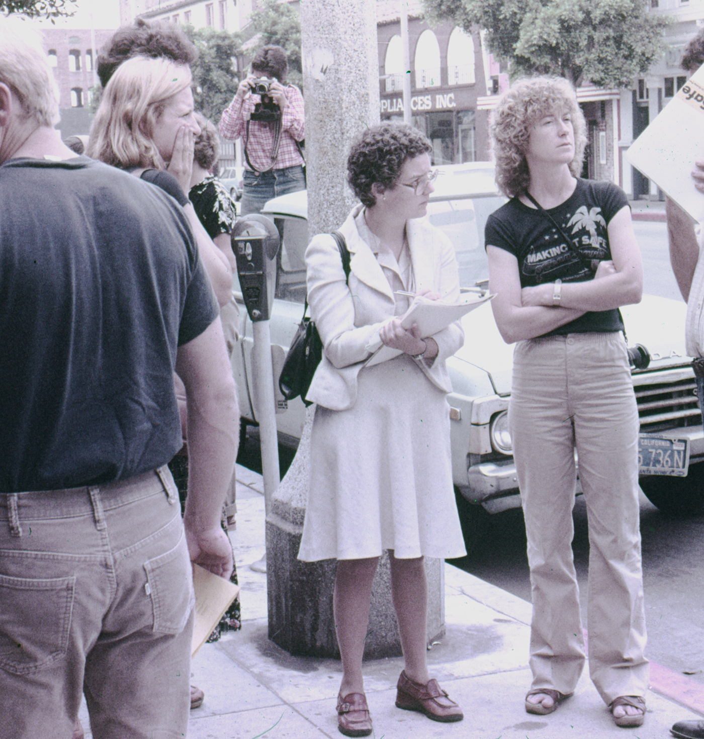 Reporter interviewing Suzanne Lacy (right)