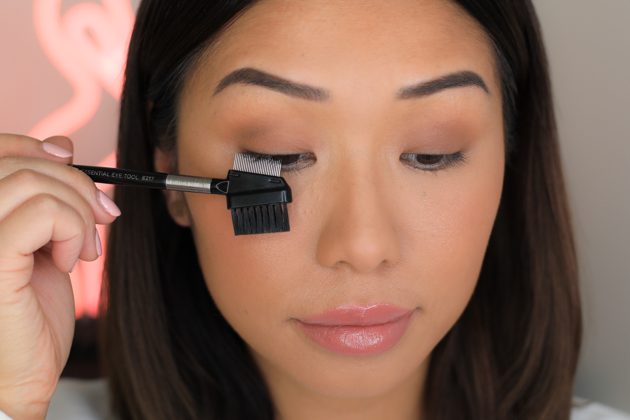 - Step 1: Comb and separate your lashes using the Urban Decay Essential Eye Tool.