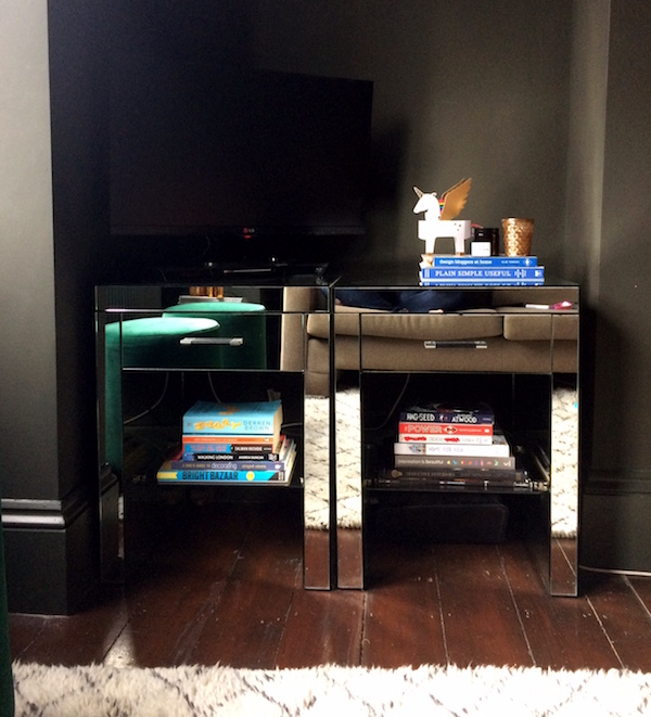 Bedside cabinets as a TV stand. Decorating tricks like shopping your home can save hundreds.