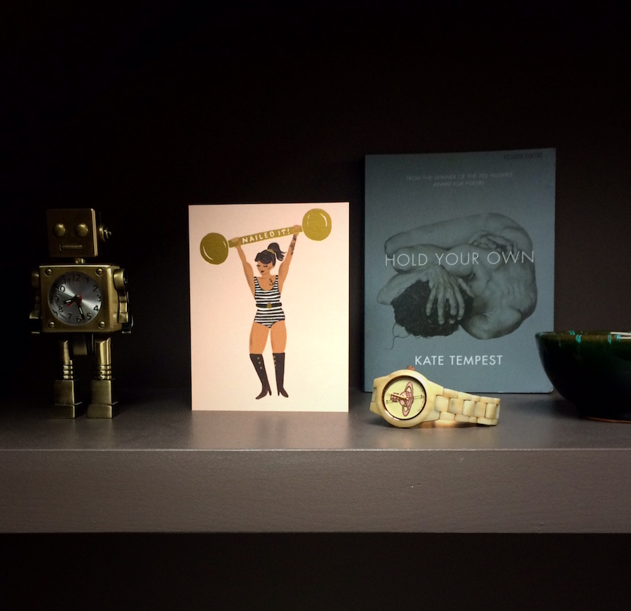 Inexpensive things like greetings cards and book covers used as art