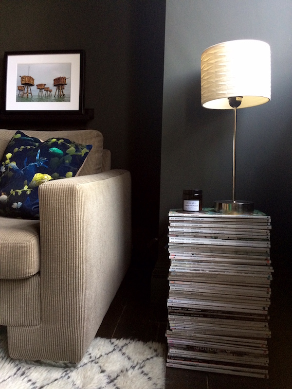 Decorating tricks to save money. Try a stack of magazines as a side table