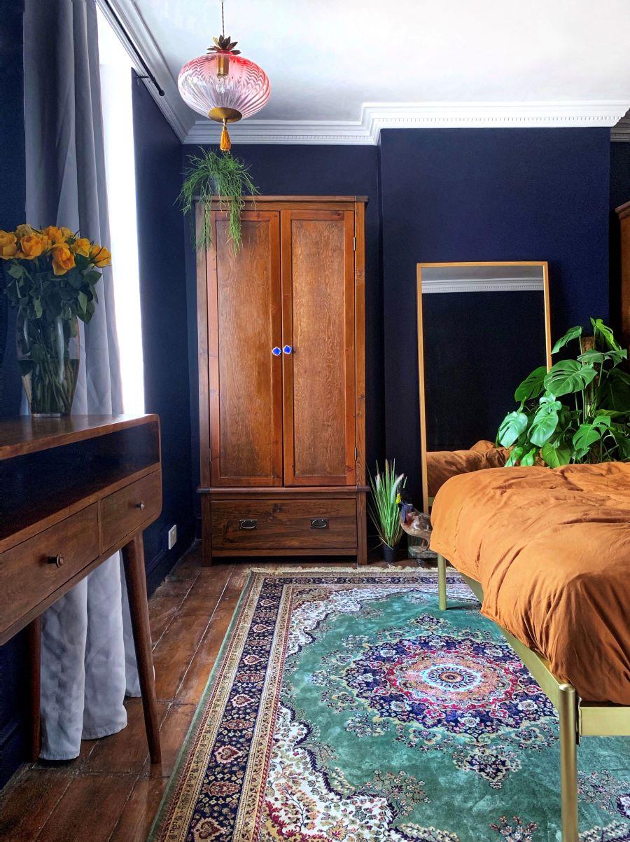 Dark blue bedroom walls can create a cocoon-like feel. Image:  Soha Ayoub