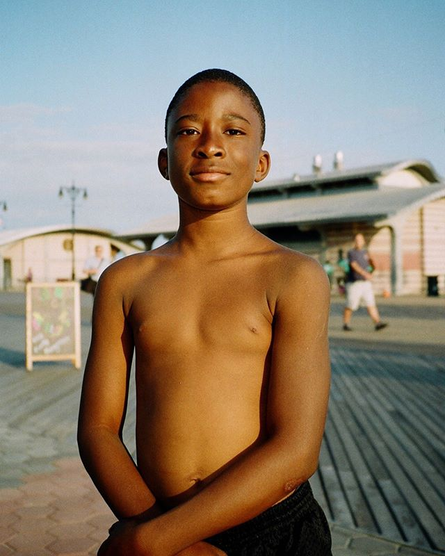 "Hello everyone, @willycoutts here on day 2 of my takeover this week. I am a portrait and documentary photographer working in Stockholm and London.  This image is from a series I made in Coney Island. This young boy was racing past me when I stopped him. He was so full of charm and assured me there was ""No need to rush, man"". I think his confidence really shines through in this portrait.  #filmsnotdead #filmphotography #35mm #35analog #back2thebase #shotonfilm #documentryphotography #streetphotography #thefilmcommunity #filmphotography #filmwave #theanalogproject #the35mmdiary #streetleaks #fujifilm #streetclassics #myspc #streetsansfrontieres #streetfinder #photographiqueuk #coneyisland #newyork"