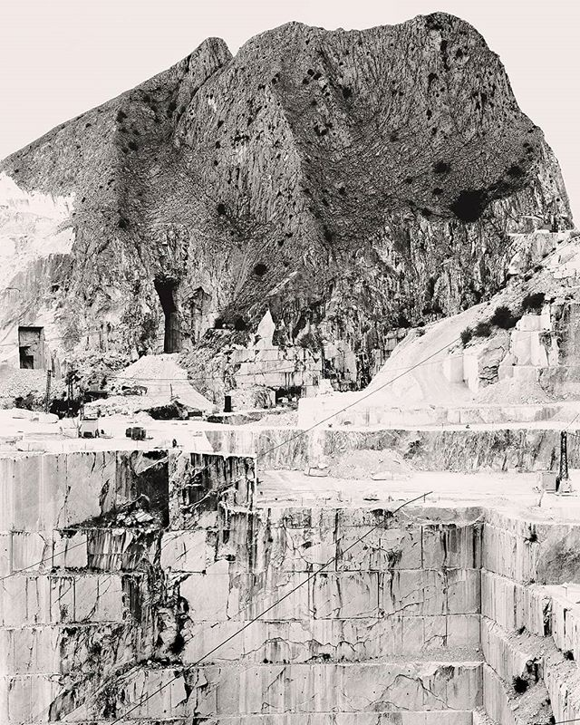 The winner of the best landscape image in The European Photoawards is Conohar Scott! With this photograph from 'Vetta e Abisso'. . Vetta e Abisso, which in English translates as Summit & Abyss, is a project documenting the famous white marble quarries of Carrara, Tuscany. The title of the project is a reference to a line from Goethe's Faust which remains, according to the scholar Marshall Berman, the pre-eminent drama on the tragedy of industrial development. The series begins at the summit of the Apuan Alps, before descending into the marble quarries, and culminating finally in the pulverisation of the rock as fragment and dust. Over one hundred marble quarries operate in the Carrara locality, and it is commonplace for illegal mining to take place in areas designated as National Park land due to the profitability of the stone. Marble of a lesser quality is also pulverised and sold as a textural agent in a variety of beauty products, such as toothpaste and face creams. Over-mining in the region is altering the micro-climate as whole mountains quite literally disappear, and for this reason mines are increasingly drilling into the Alps in a bid to hollow them out from the inside. . #europa