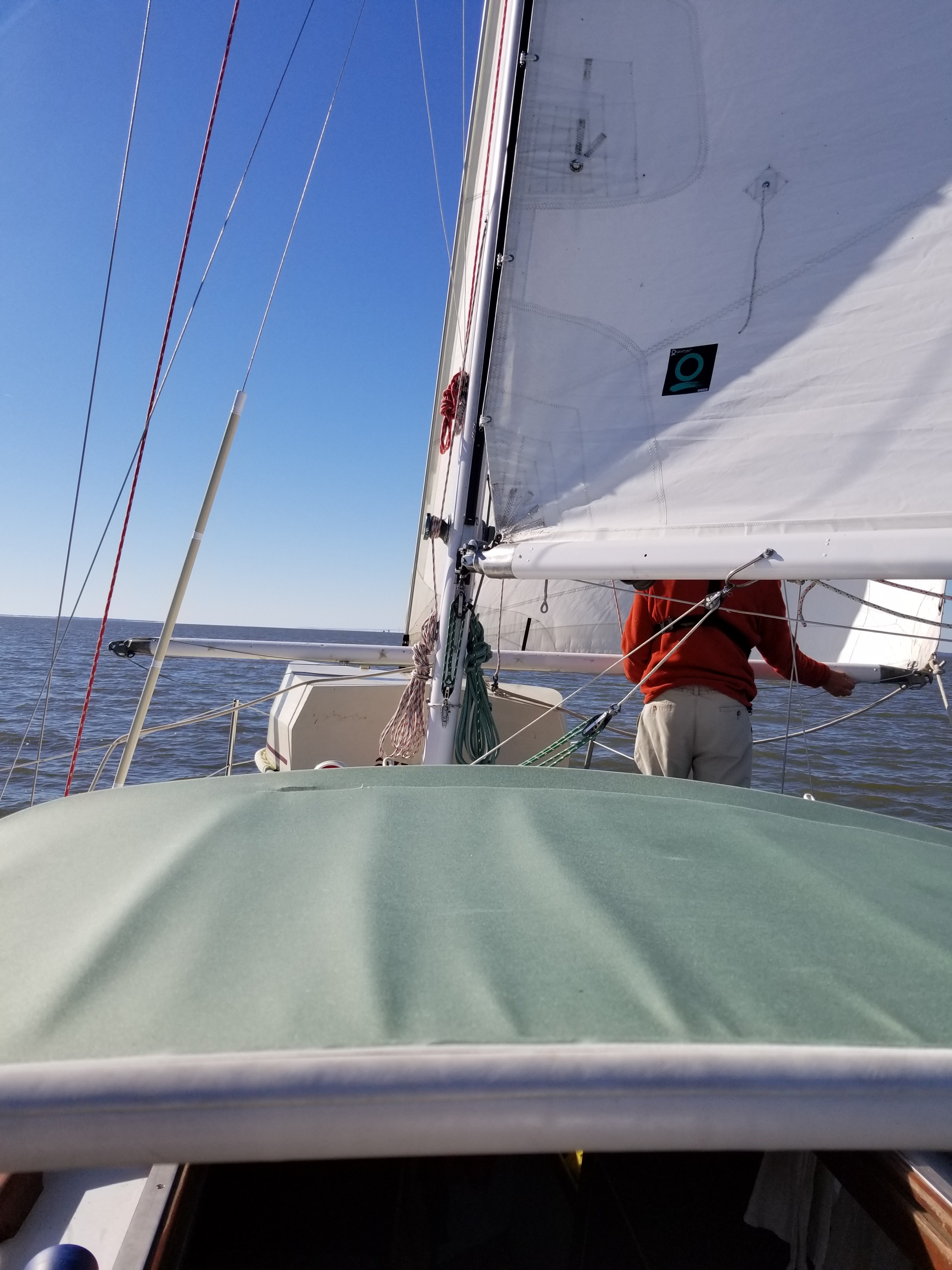 Dobbs sets the spinnaker pole as a whisker pole for the 135% genoa.
