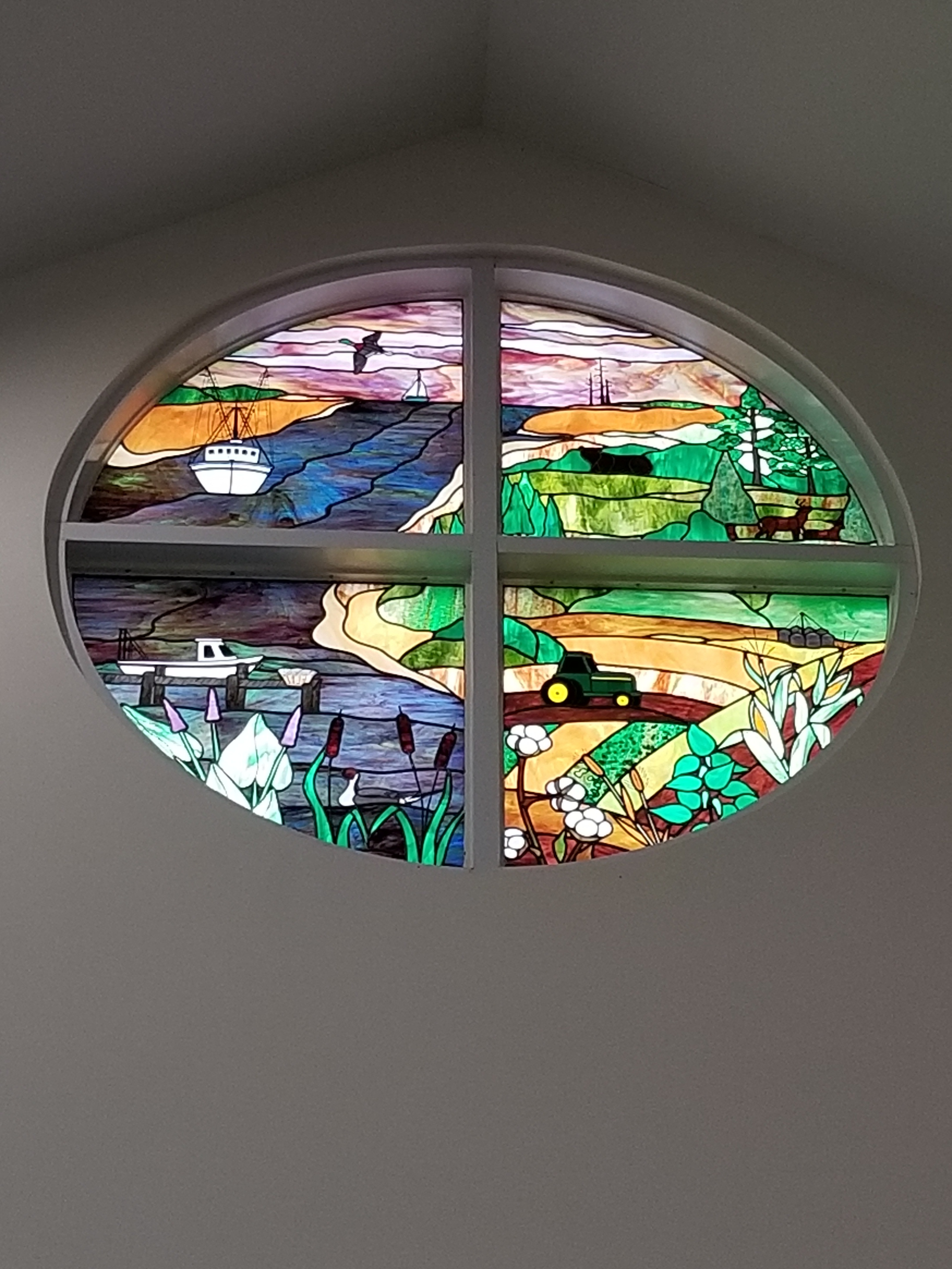 A stained glass representation of the town seal, at the front of the library.