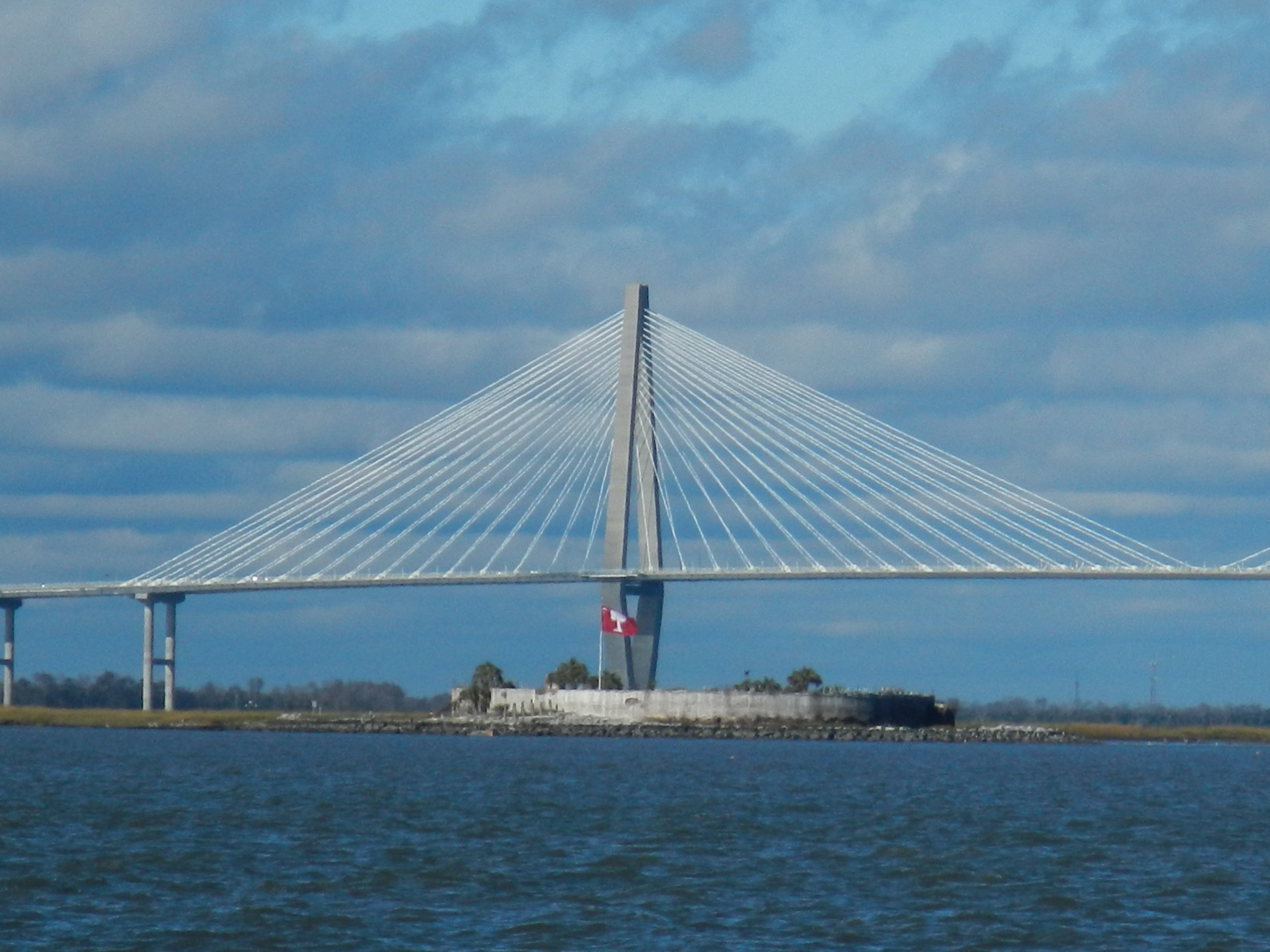 Castle Pinckney  with the Cooper River Bridge in the background.