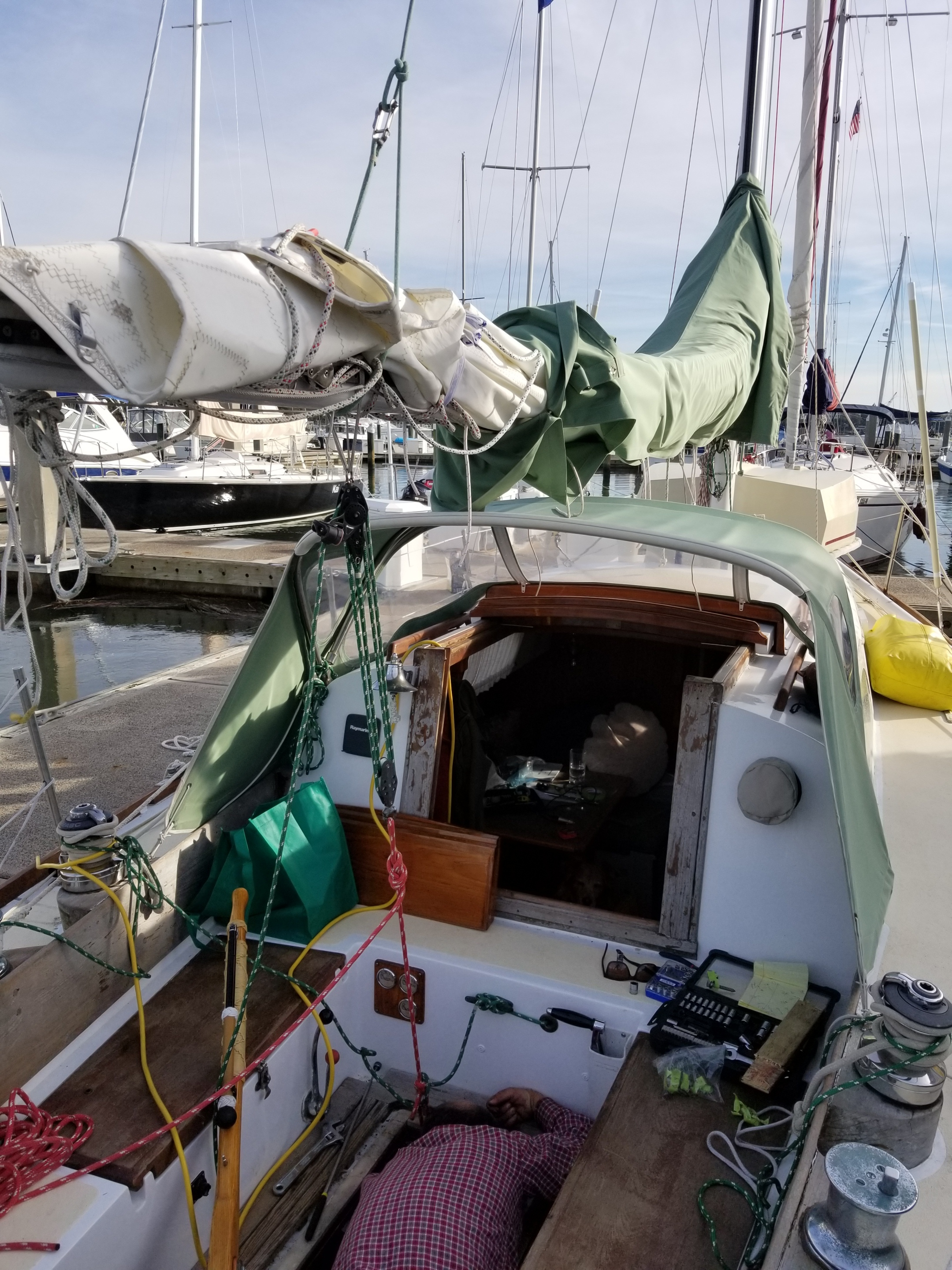 Note that when we use the boom as a crane, we attach the main halyard opposite the lifting tackle. This way, the boom doesn't bow under the load.