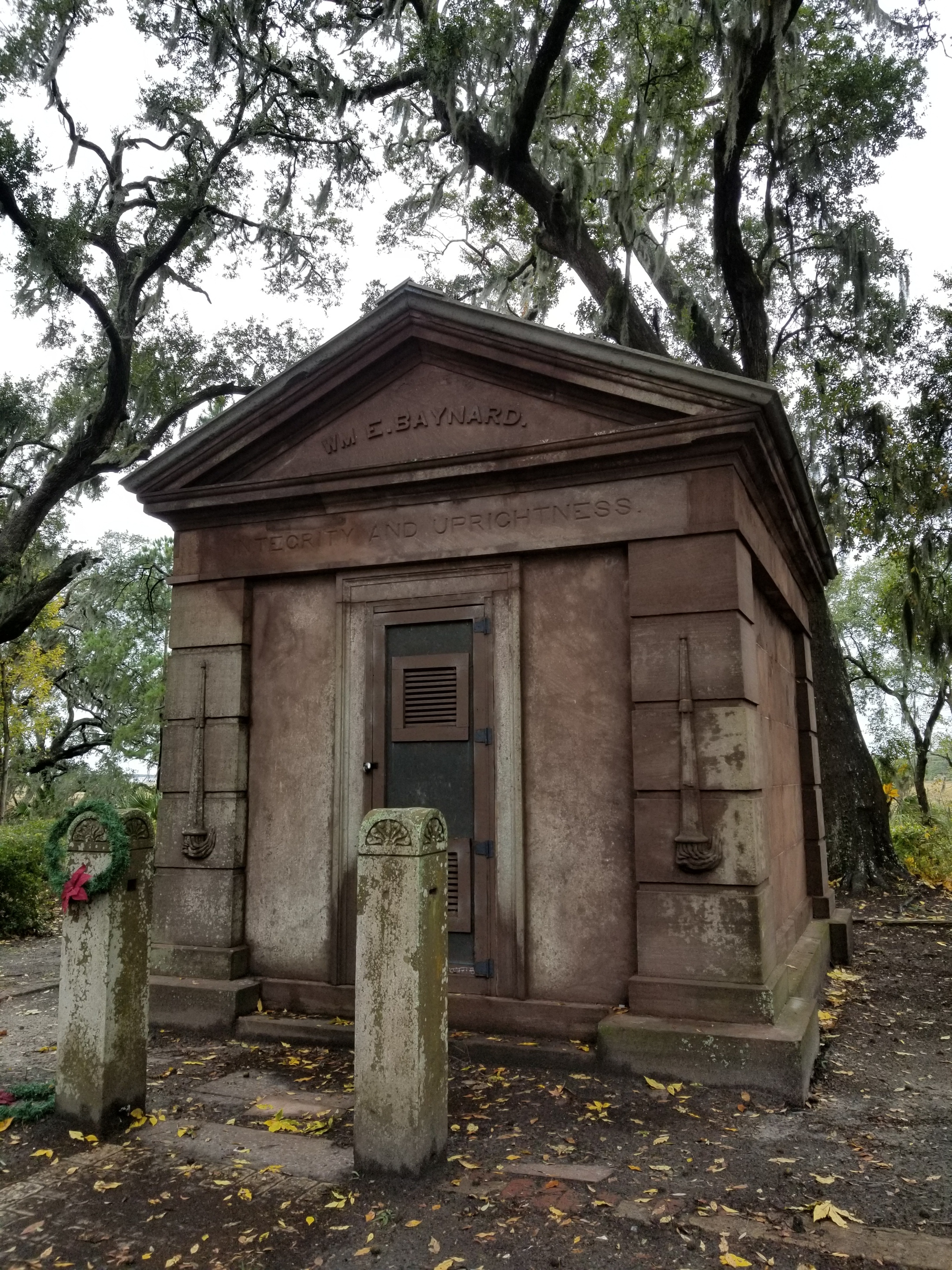 The Baynard Mausoleum - the oldest standing structure on Hilton Head Island. Note that the torches on the front of the building are upside down to symbolize a life cut short - Baynard died at 49 in 1849.  Click on this photo to see a 1-minute video about the restoration of the bluestone slab roof.