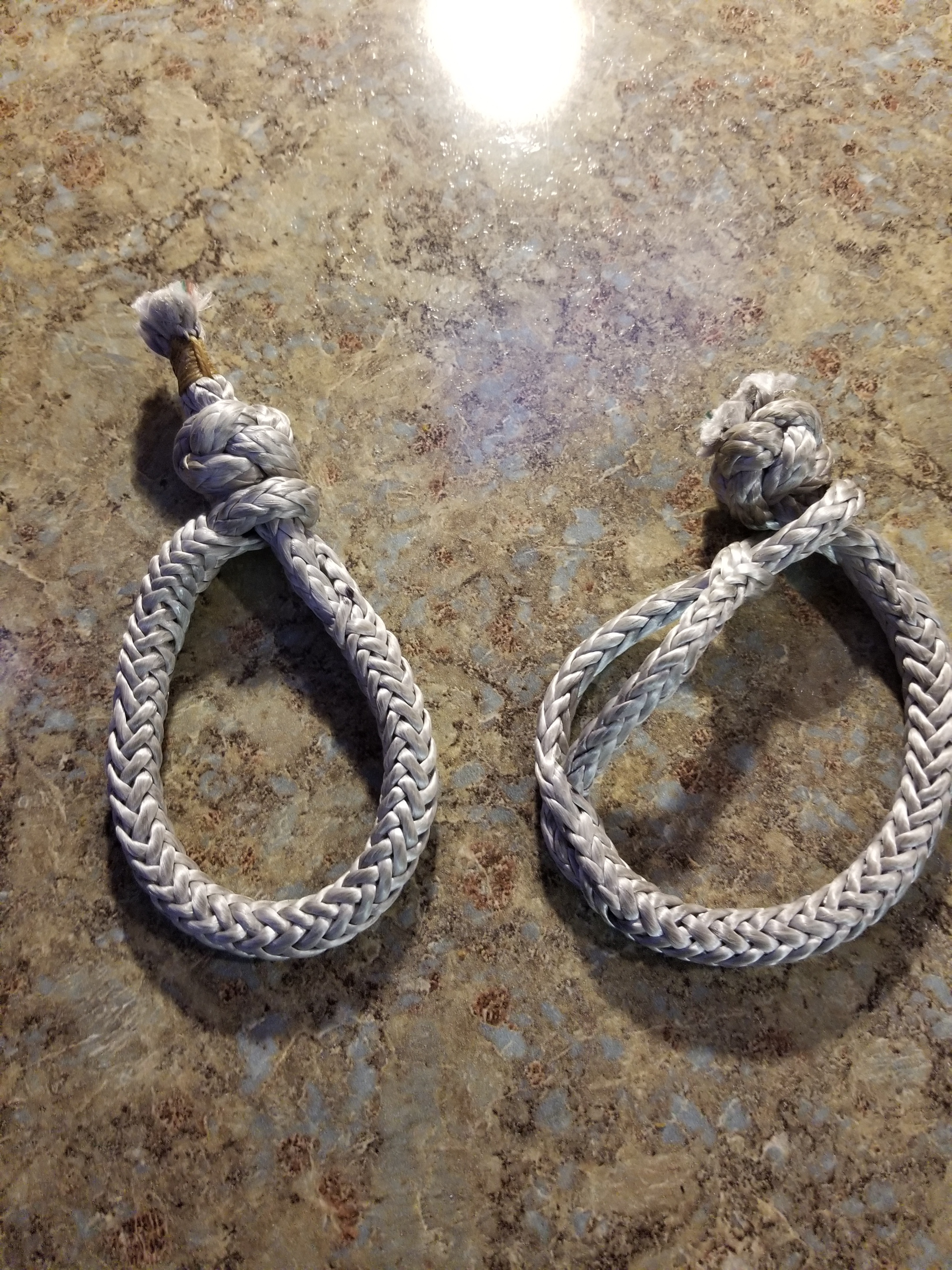 Side-by-side, a standard soft shackle (on left)  and an Edwards soft shackle (on right).  The Edwards soft shackle is reportedly eaiser to undo after it's seen a load.  We'll test both.