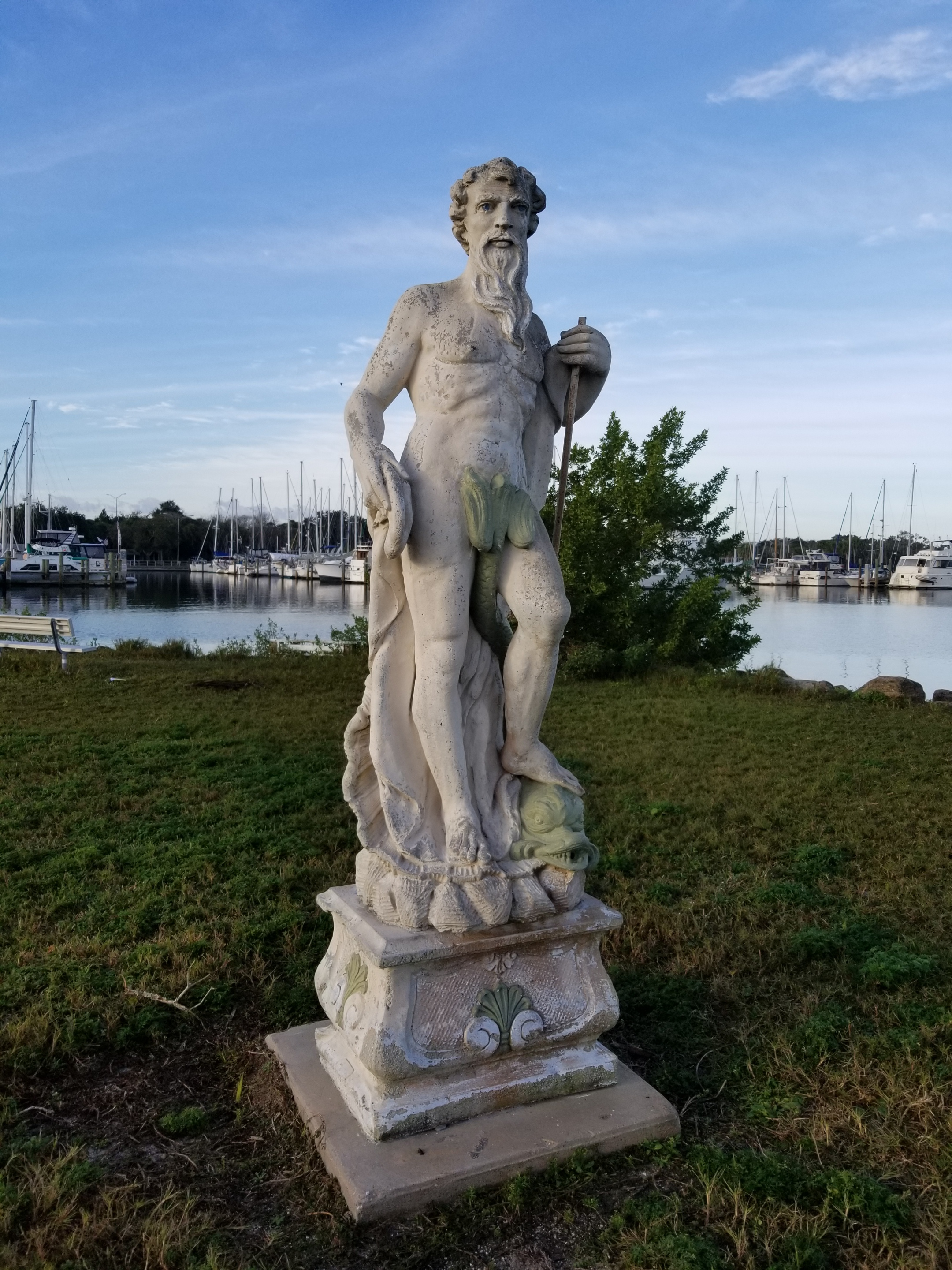 Musings from morning dog walking:  This fellow stands on the point of the southern jetty that protects the marina.  I feel like he's looking right at me (which makes it hard to inspect and figure out what the fish tail is doing attached to his groin…).