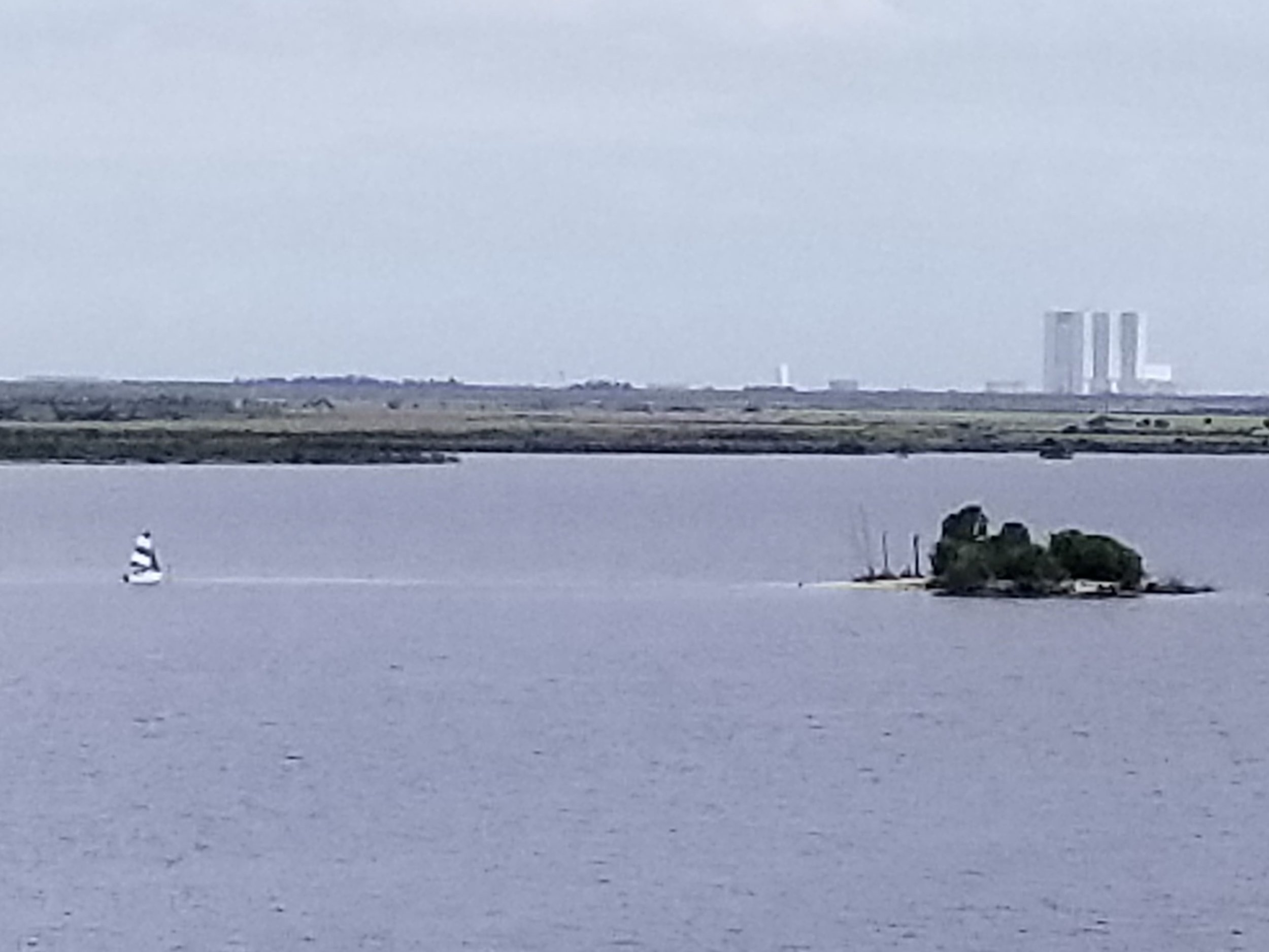 A tiny sailboat out for day-tripping island adventure.