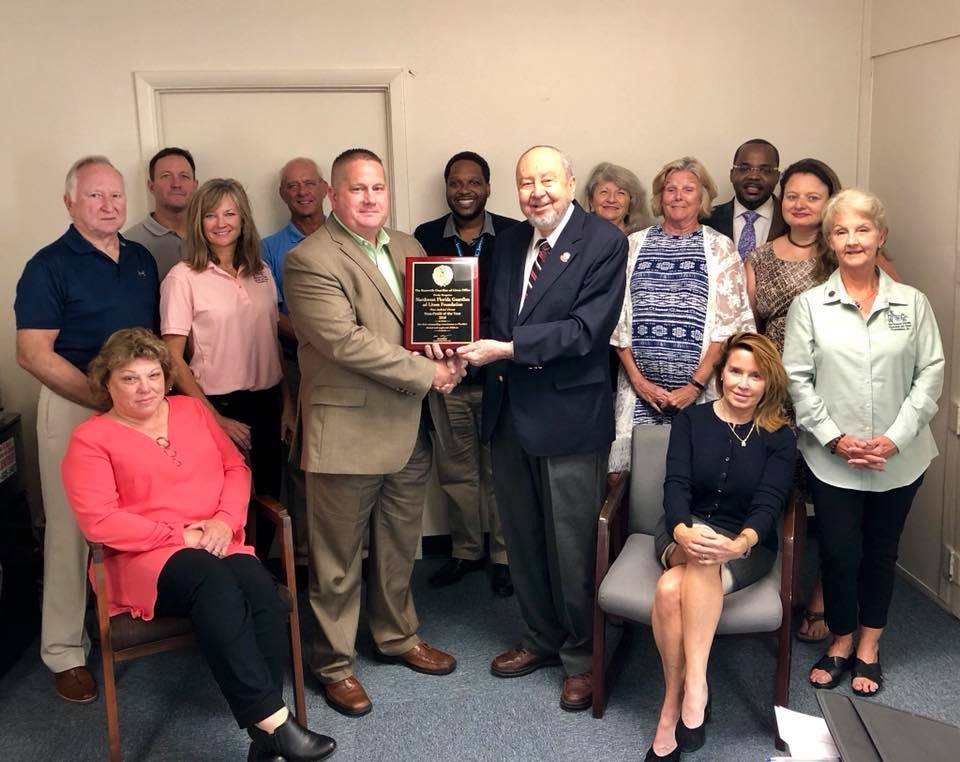 Bryan Carter, First Circuit Director presents award to Charles E. Schuster, NW Florida GAL Foundation President, present with the rest of the board