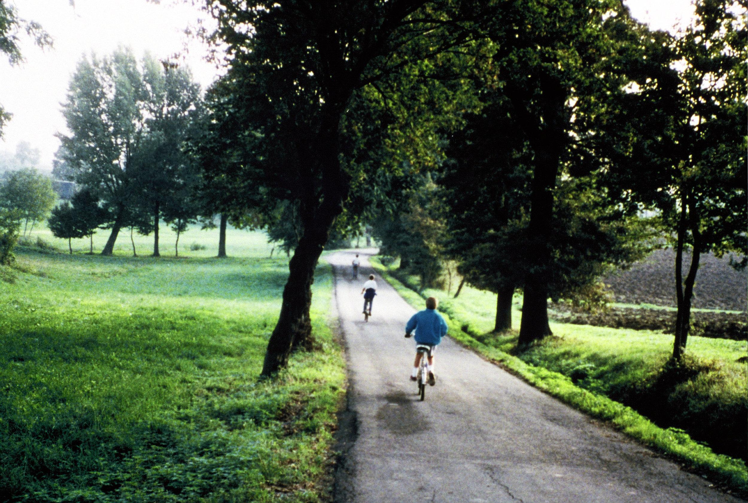 Chris, Alden and Ashley biking in the countryside outside Reggio Emilia.
