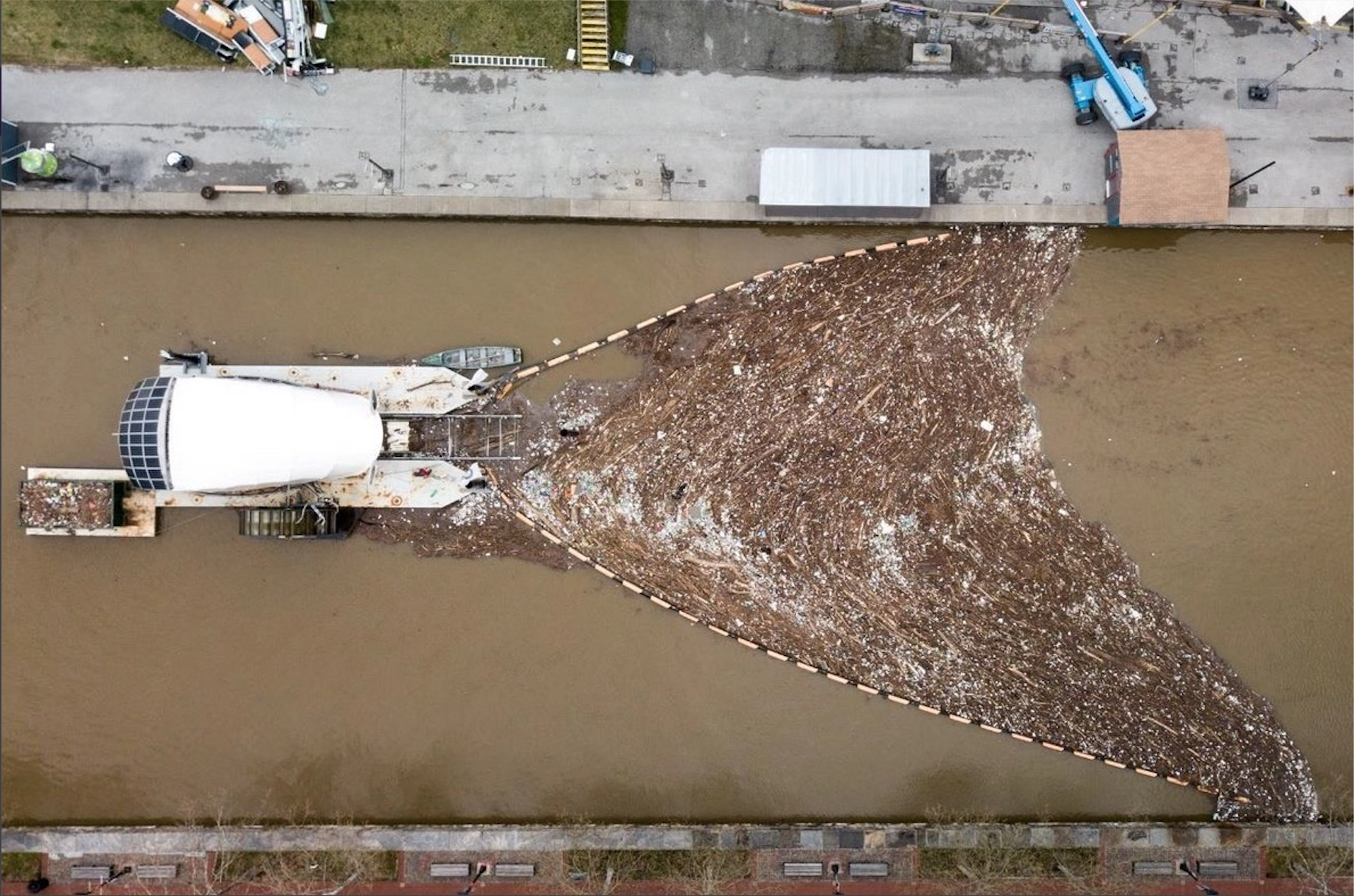 "Aerial view of ""Mr. Trash Wheel"" river plastics intervener, Baltimore, MD (Clearwater Mills)"