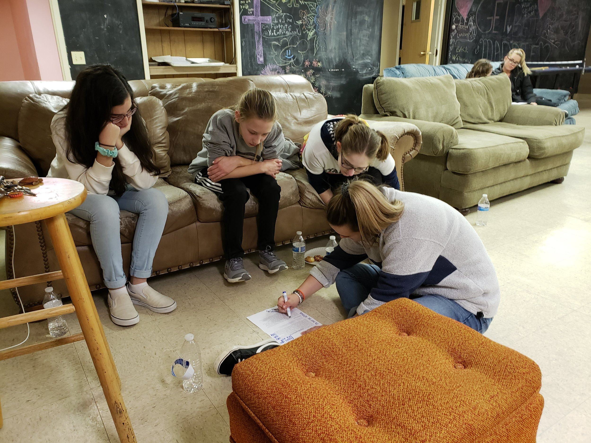 MADDIE HENRY, A HIGH SCHOOL JUNIOR AT PENN MANOR  (bottom right) LEADS A SMALL GROUP OF GIRLS THROUGH A BIBLE STUDY
