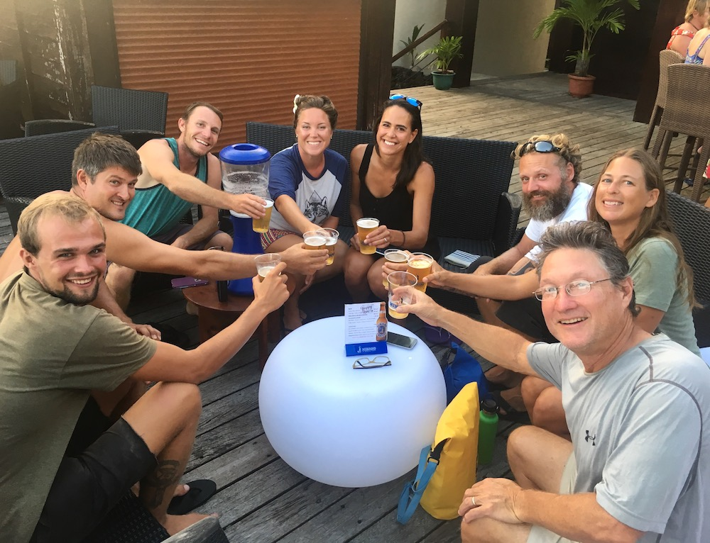 "Cruising friends share a ""tower"" of Hinano Beer in Bora Bora before departure! Most of these friends we've been cruising with since La Cruz, Mexico!"