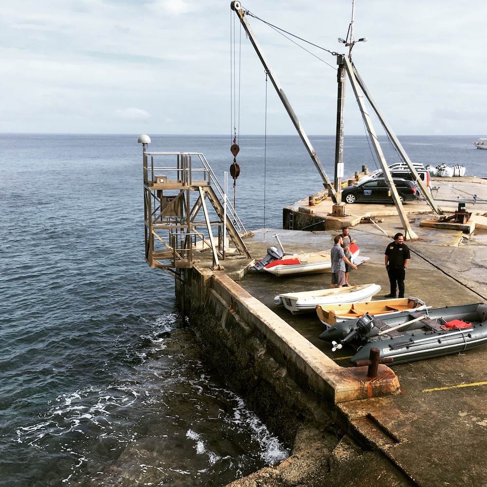 View of the Niue Wharf and the dinghy/boat crane.