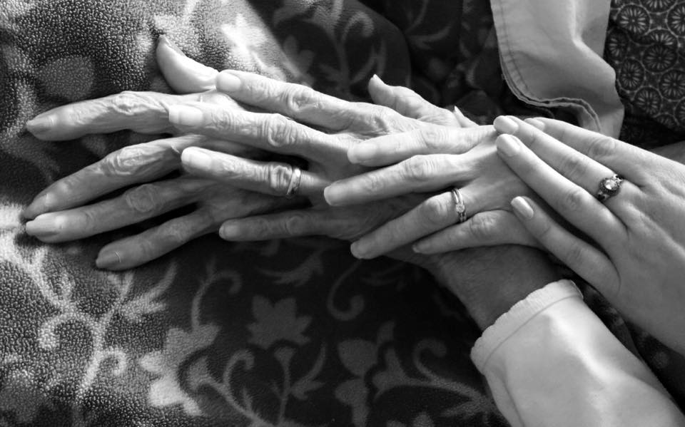 Four generations:  This photo shows more than just hands (L to R: My Granny, my Ninny, my mom, me). It shows the connection and love four women have for each other, in life and even when we are gone. Although it's black and white, it invokes emotion and tells a multi-generational story through four different people.