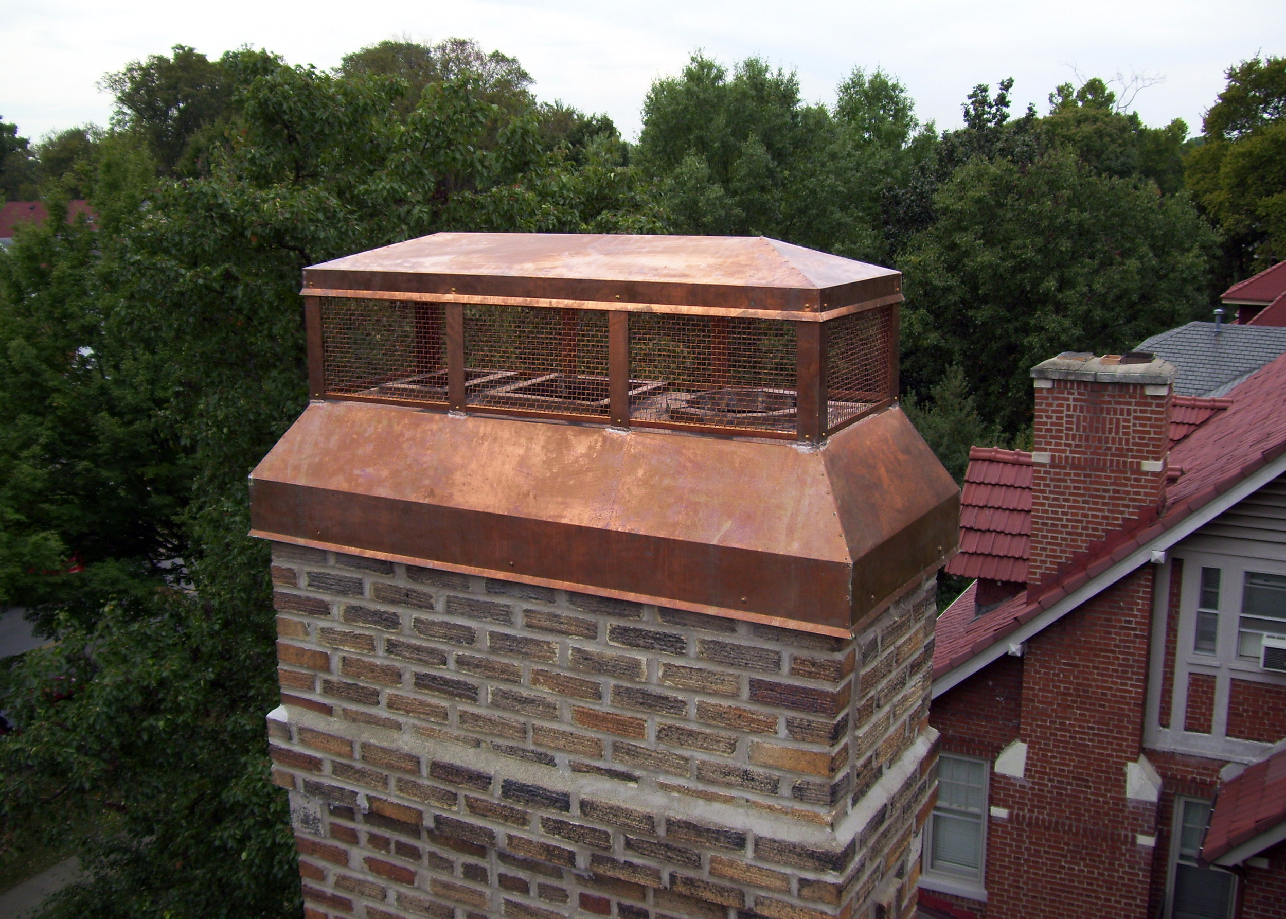 Cold rolled copper chimney cap. (Fabricated and installed by Merrick-Kemper)
