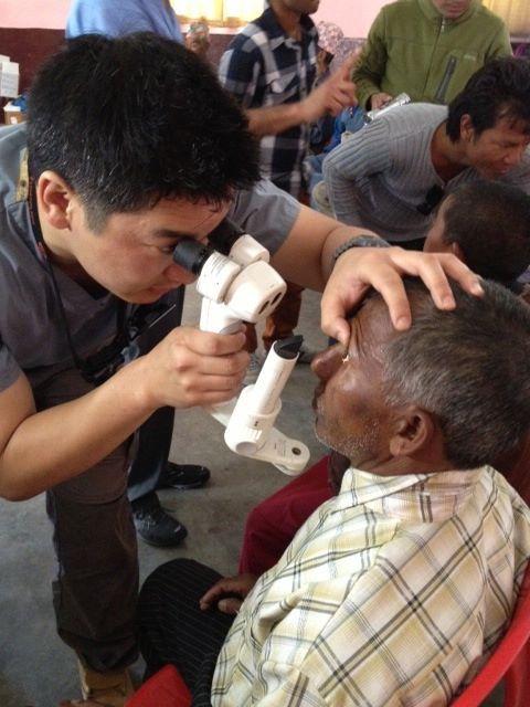 Christopher Teng, MD, conducts post op exam in Marpha, Nepal.