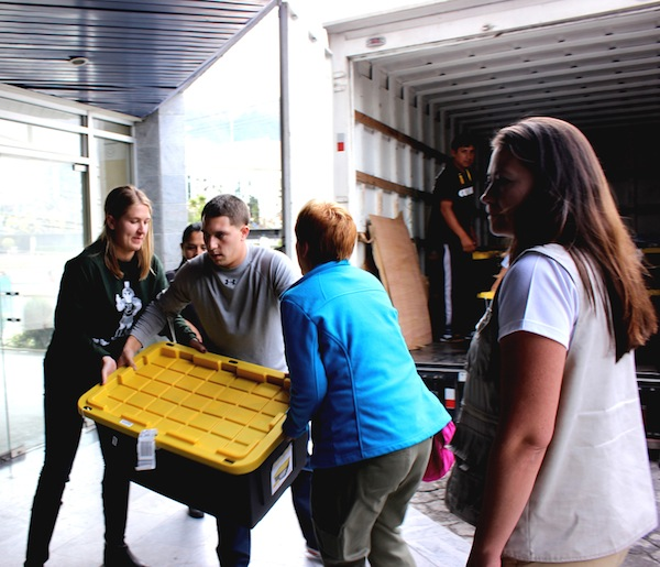 Emily, Matt, and Amanda load one of the many heavy crates onto the truck to take to the hospital in Riobamba.