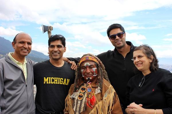 Pradeep, Rita, Brad, and Praveen pose together with man dressed in Inka attire.