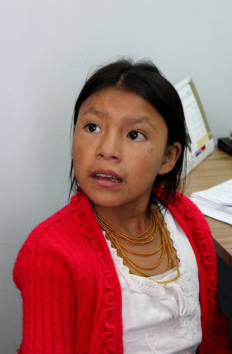 A young patients listens as translators tell the girl and her family the next course of action.