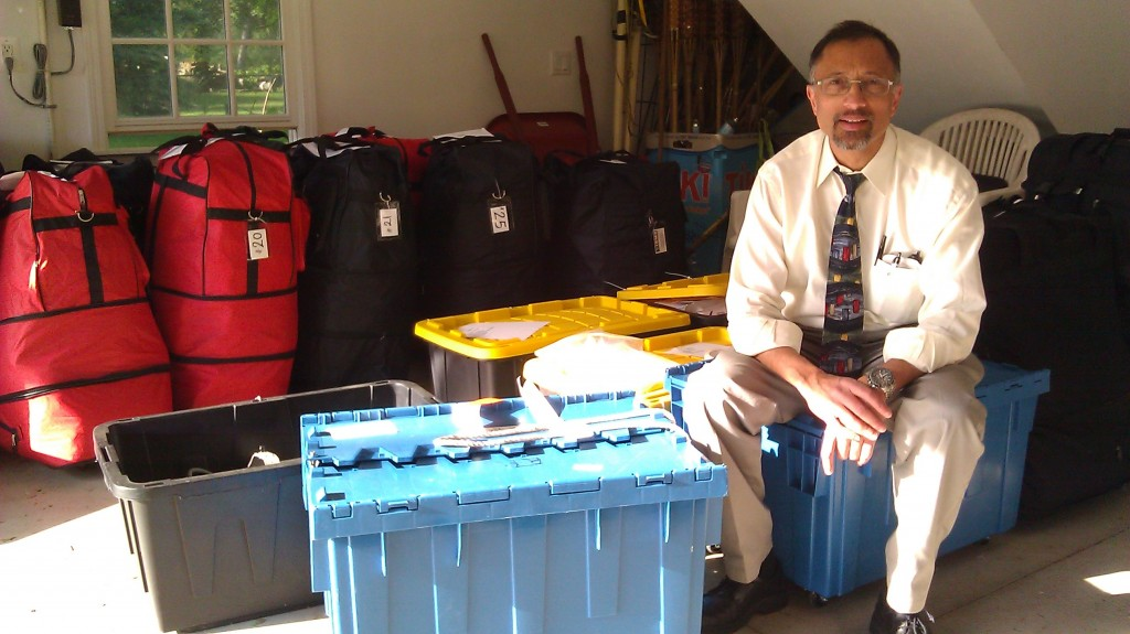 Dr Mehul Mehta taking a break from packing supplies for the mission to Kakamega.