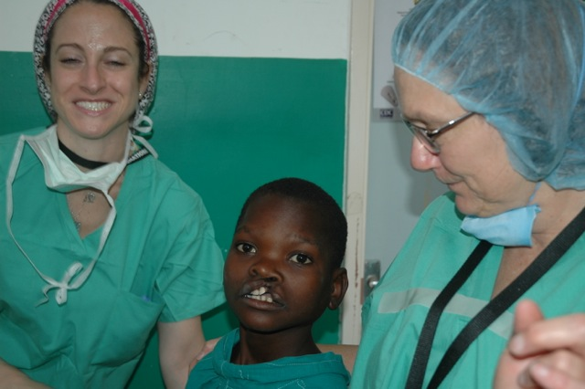 OR team waiting to operate and 12 yr old boy- cleft lip