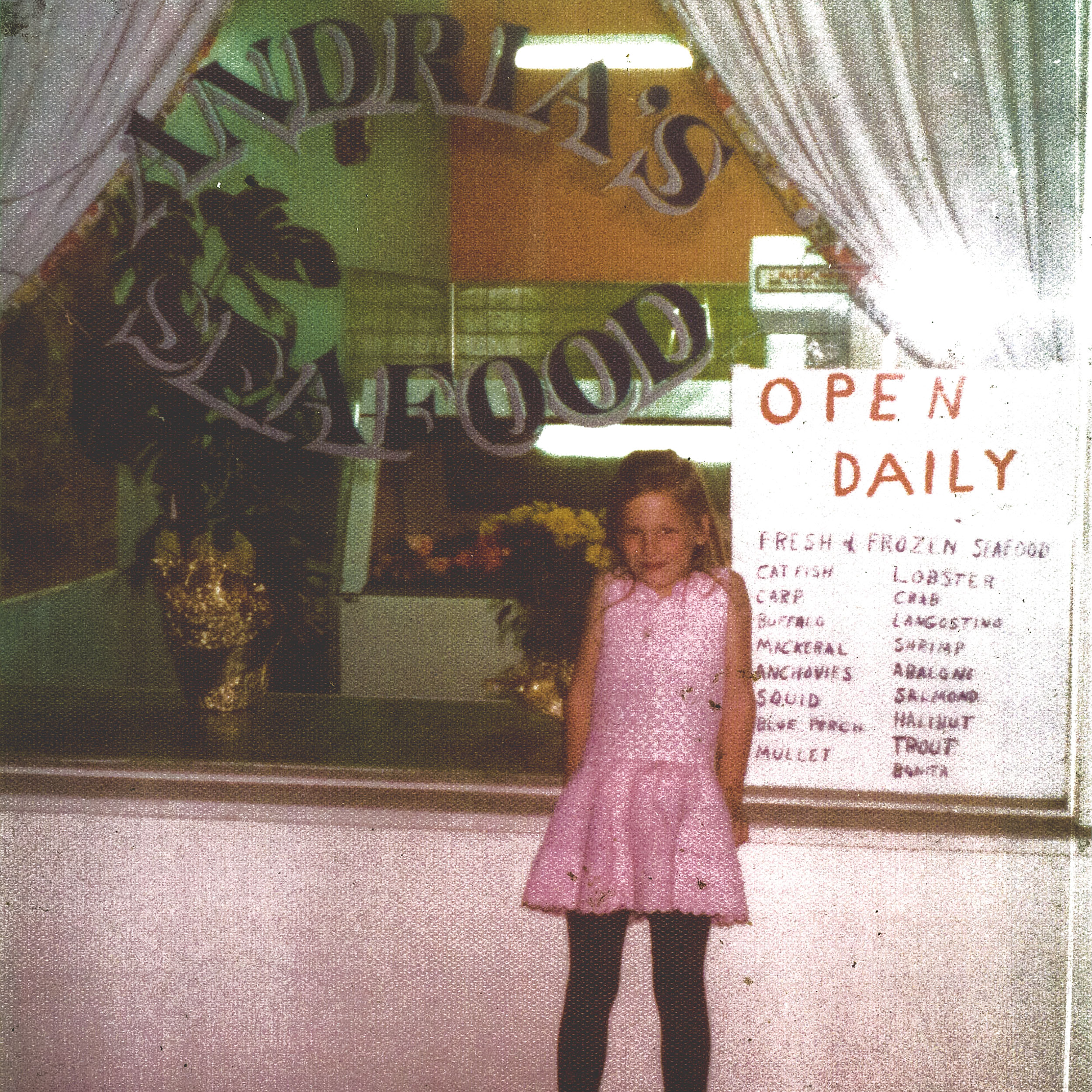 Andria Wagner as a child in front of the original Andria's Seafood