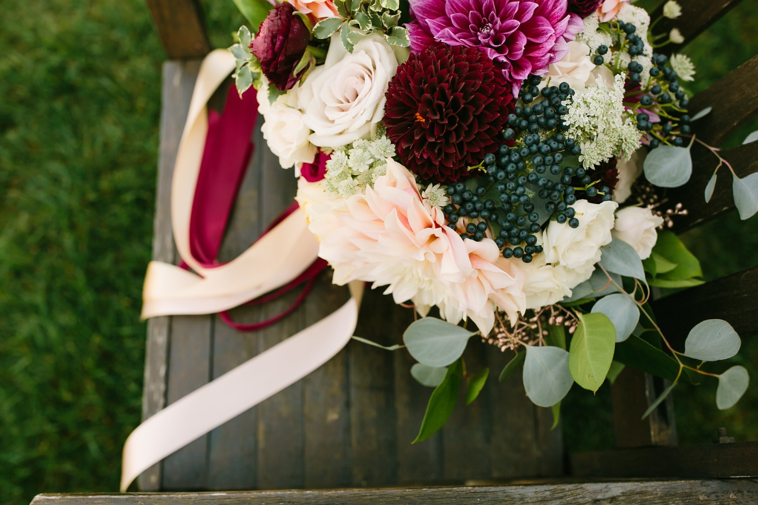 misty farm wedding flowers by red poppy