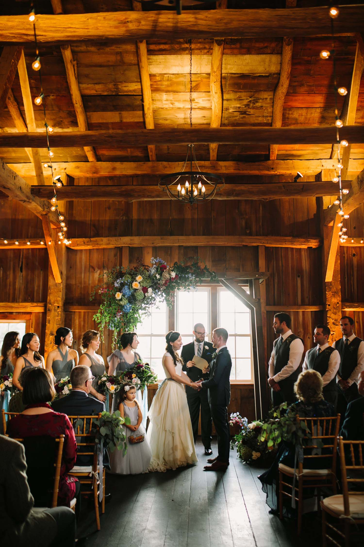 cornman farms indoor barn wedding ceremony