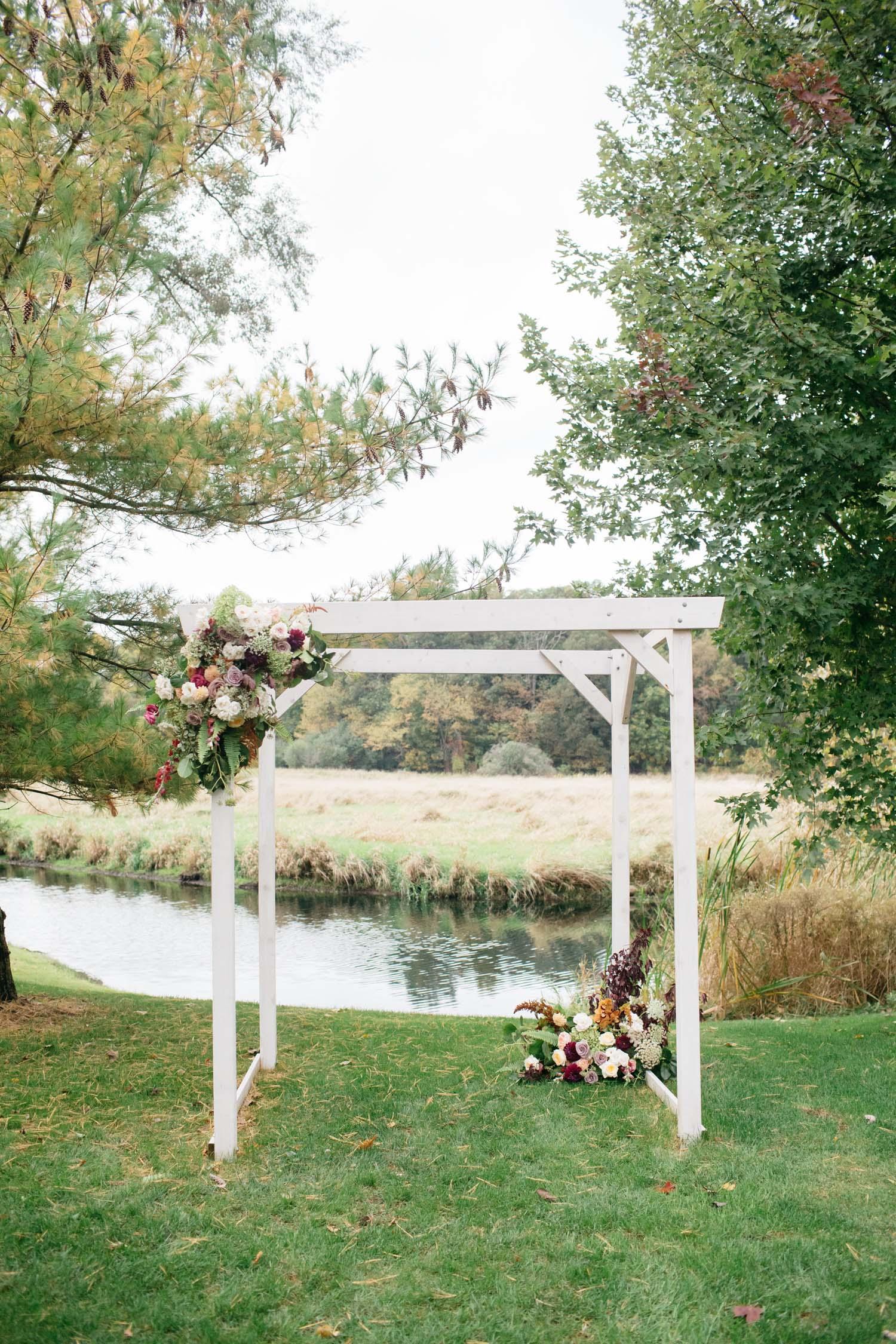 misty farm ceremony arch flowers